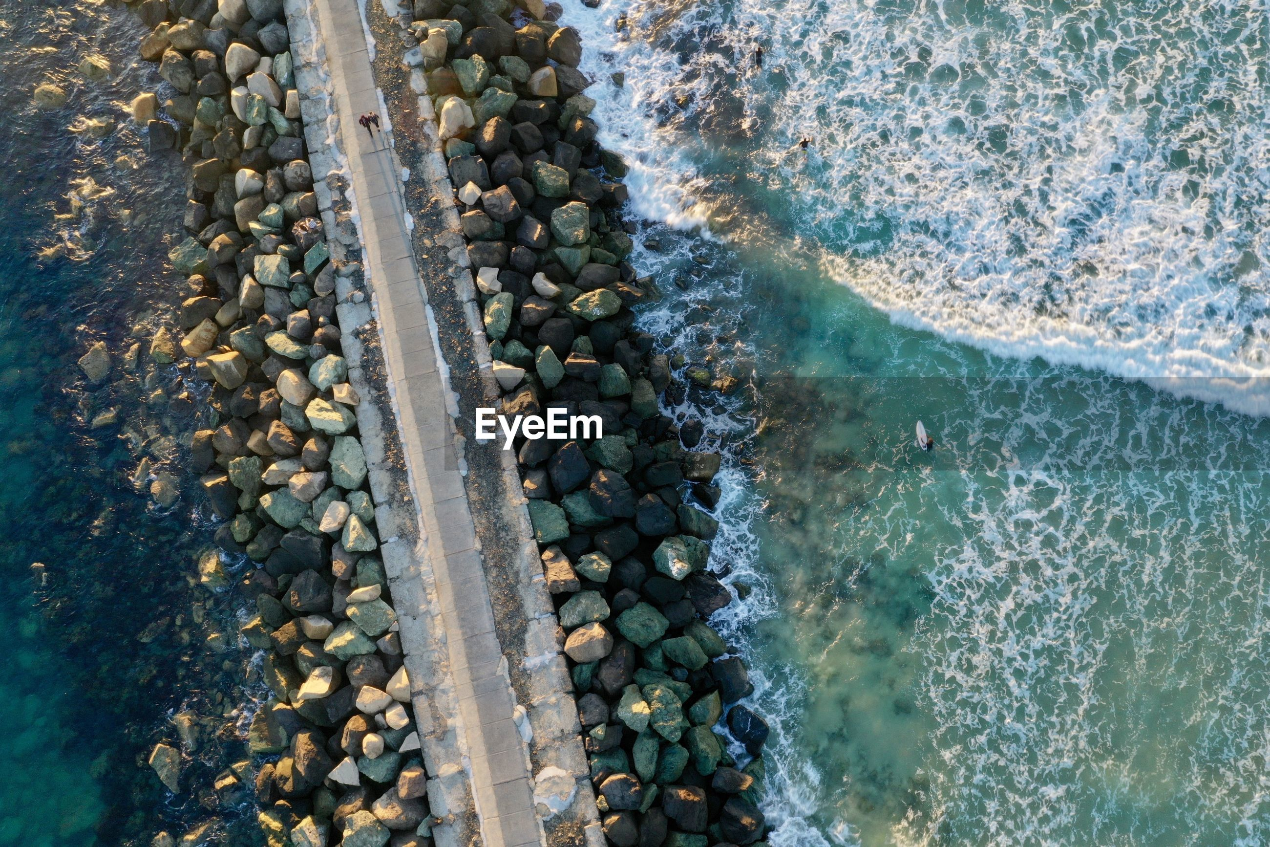 Aerial view of footpath by sea
