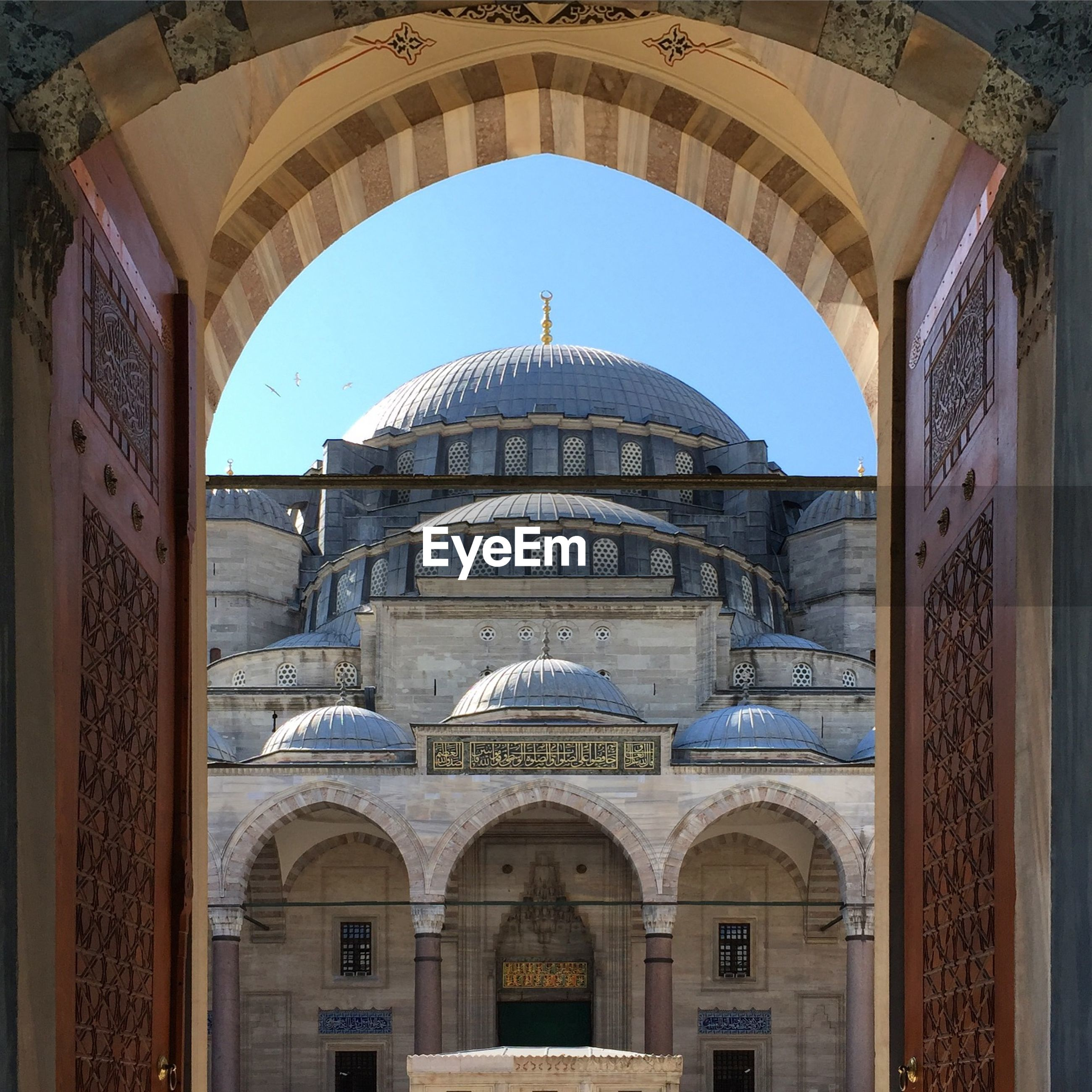 Low angle view of suleymaniye mosque seen through arch door