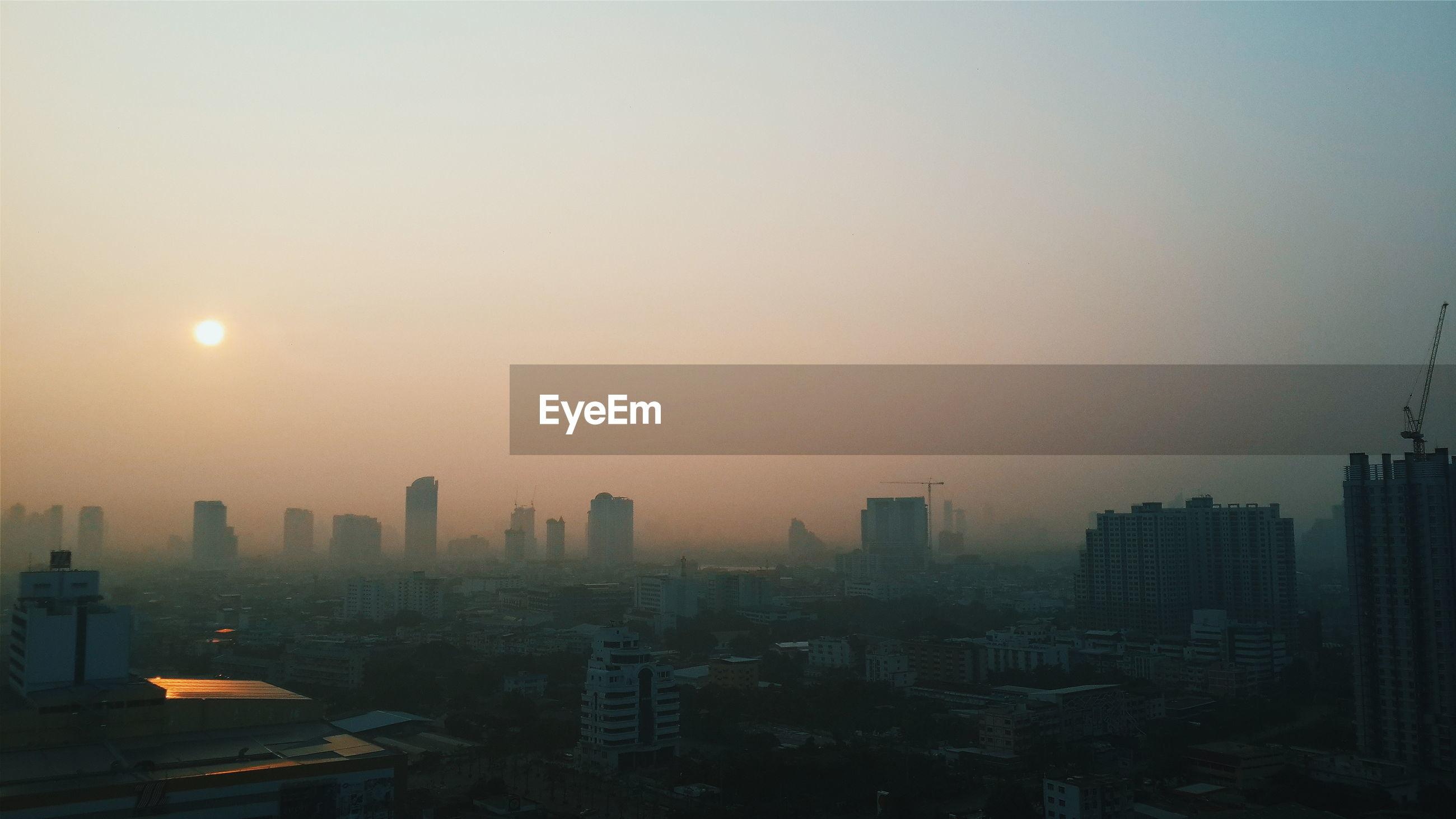 MODERN CITY AT SUNSET