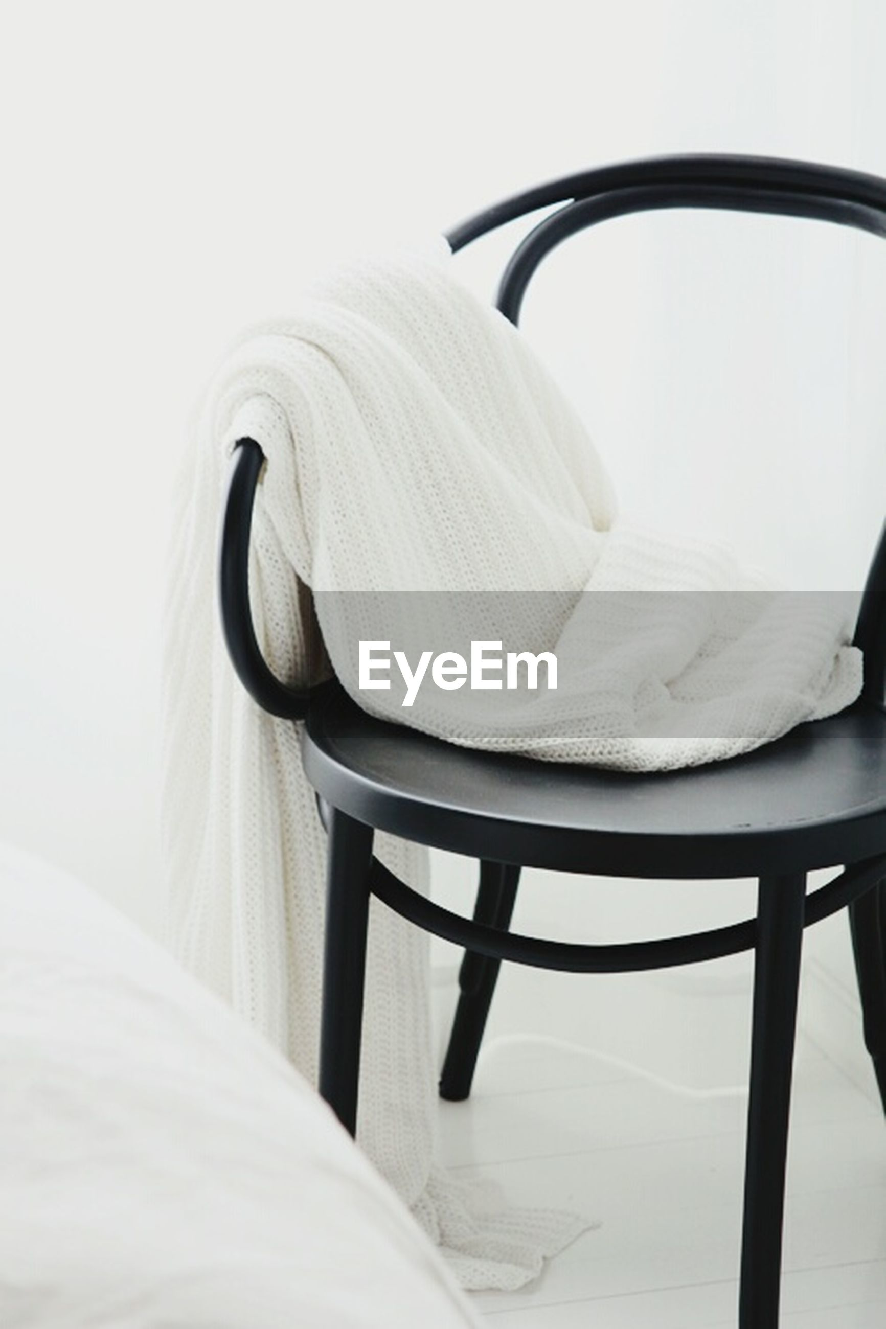 chair, towel, indoors, bed, no people, home interior, domestic room, seat, close-up, bedroom, day