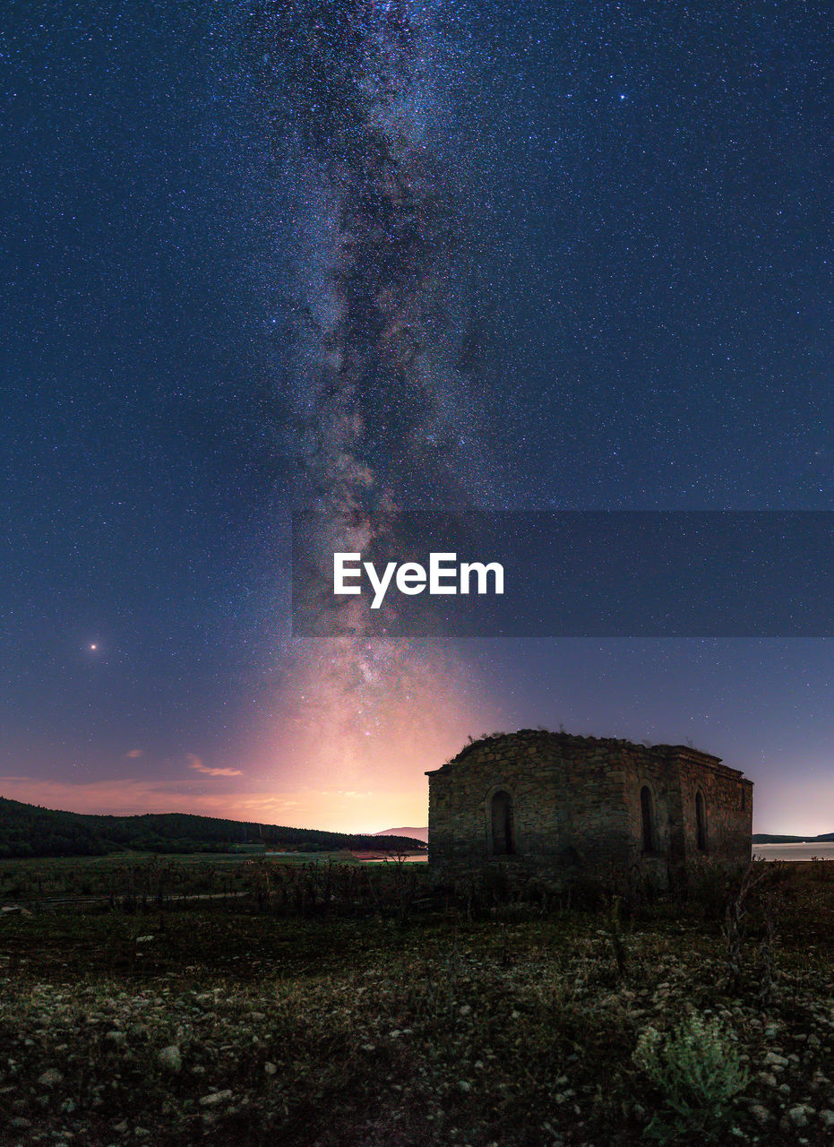 sky, scenics - nature, star - space, astronomy, nature, night, space, architecture, beauty in nature, land, no people, environment, tranquility, field, tranquil scene, galaxy, history, landscape, built structure, the past, outdoors, milky way, ruined