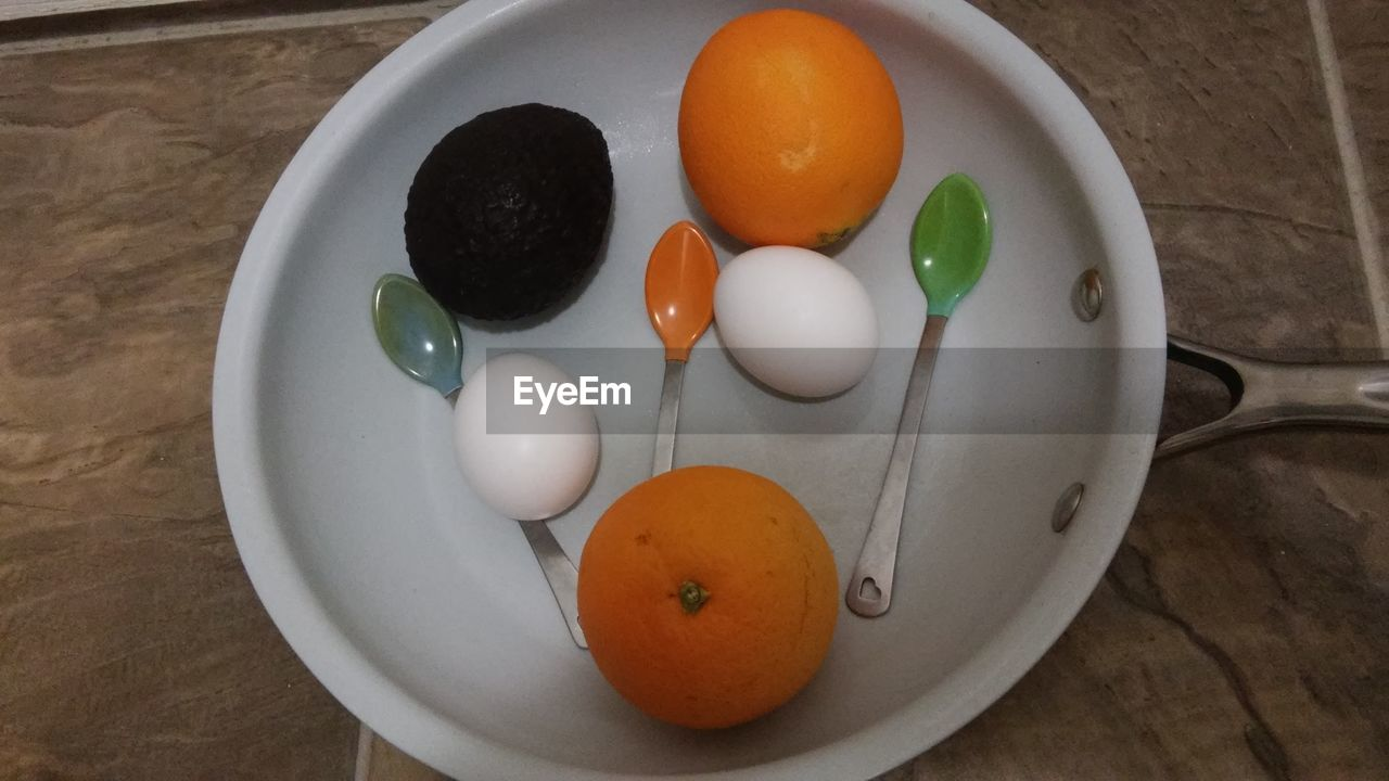 table, food and drink, indoors, healthy eating, freshness, food, high angle view, fruit, no people, close-up, day, egg yolk