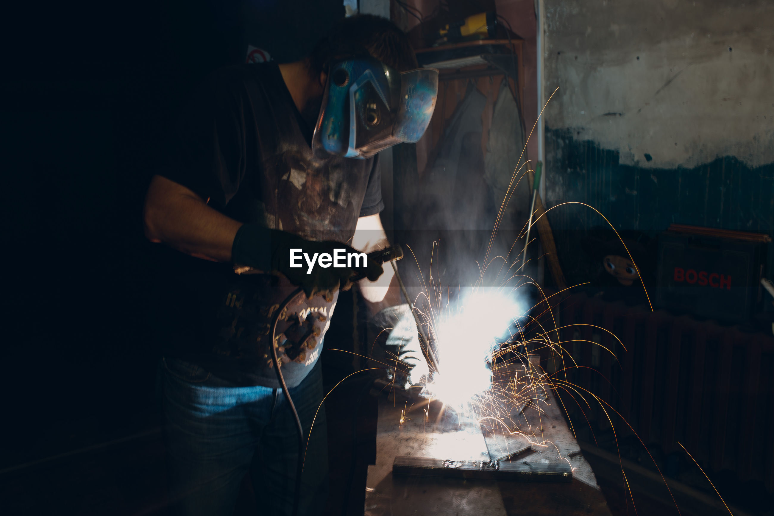 Man welding in workshop