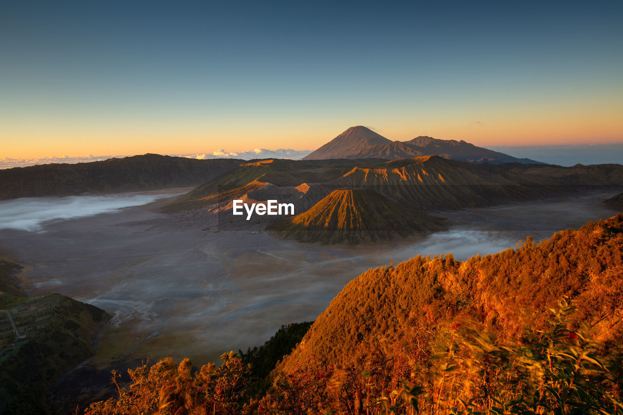 scenics - nature, mountain, sky, beauty in nature, tranquil scene, non-urban scene, sunset, tranquility, volcano, landscape, environment, idyllic, nature, orange color, no people, land, clear sky, travel destinations, geology, remote, outdoors, volcanic crater, power in nature, mountain peak