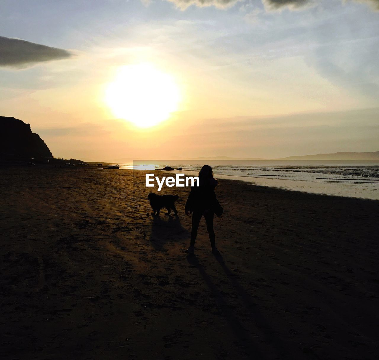 beach, sunset, sea, sand, nature, silhouette, dog, sky, scenics, walking, beauty in nature, water, horizon over water, pets, tranquil scene, domestic animals, togetherness, two people, tranquility, mammal, full length, real people, men, outdoors, friendship, day, people