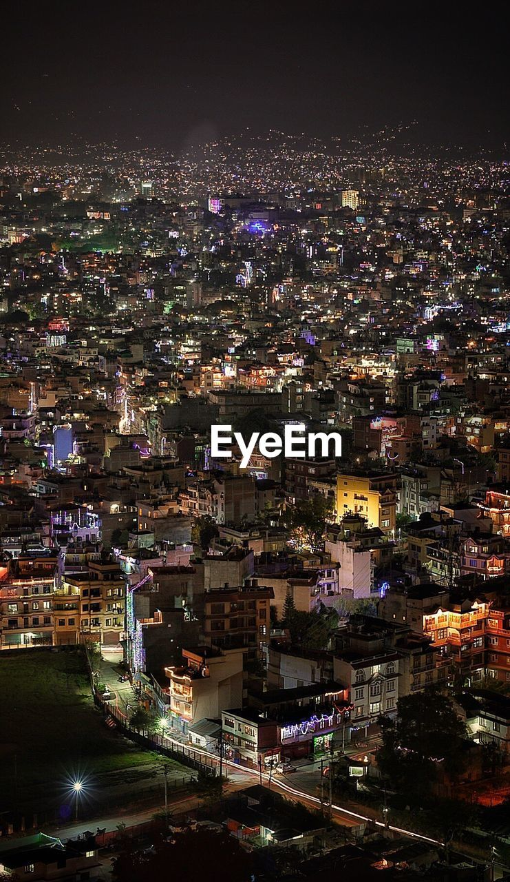 night, illuminated, cityscape, city, architecture, crowded, building exterior, high angle view, outdoors, travel destinations, built structure, skyscraper, sky, people