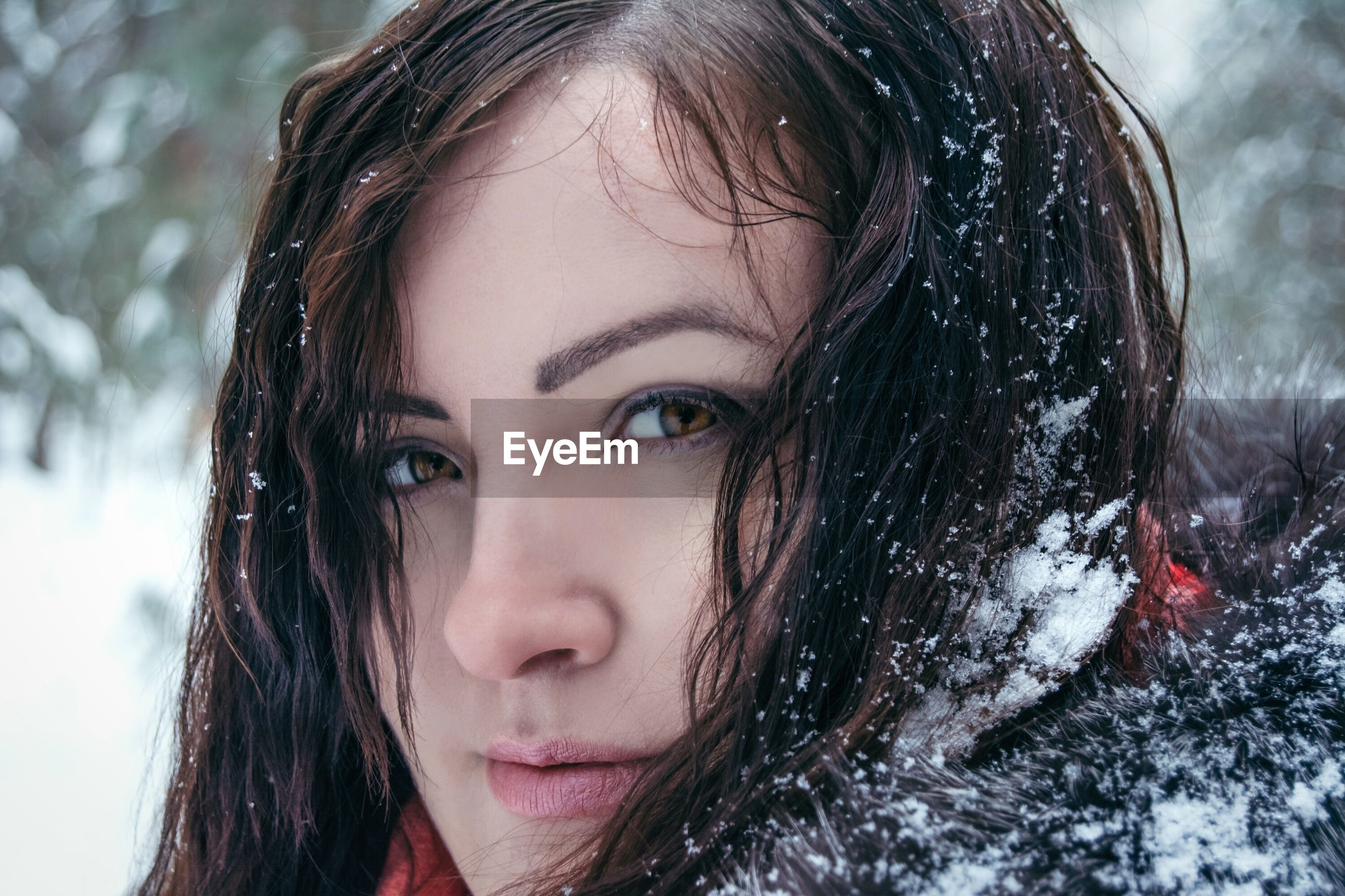 Close-up portrait of woman in snow