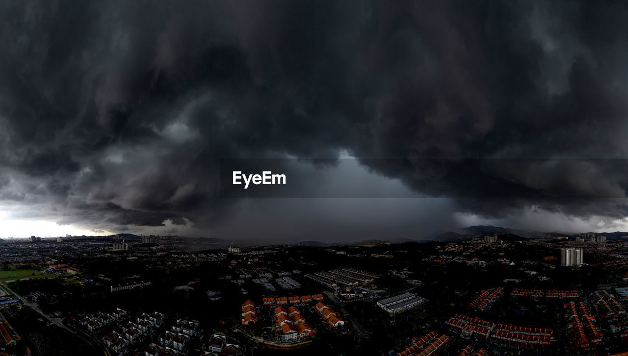 High angle view of cityscape against storm clouds