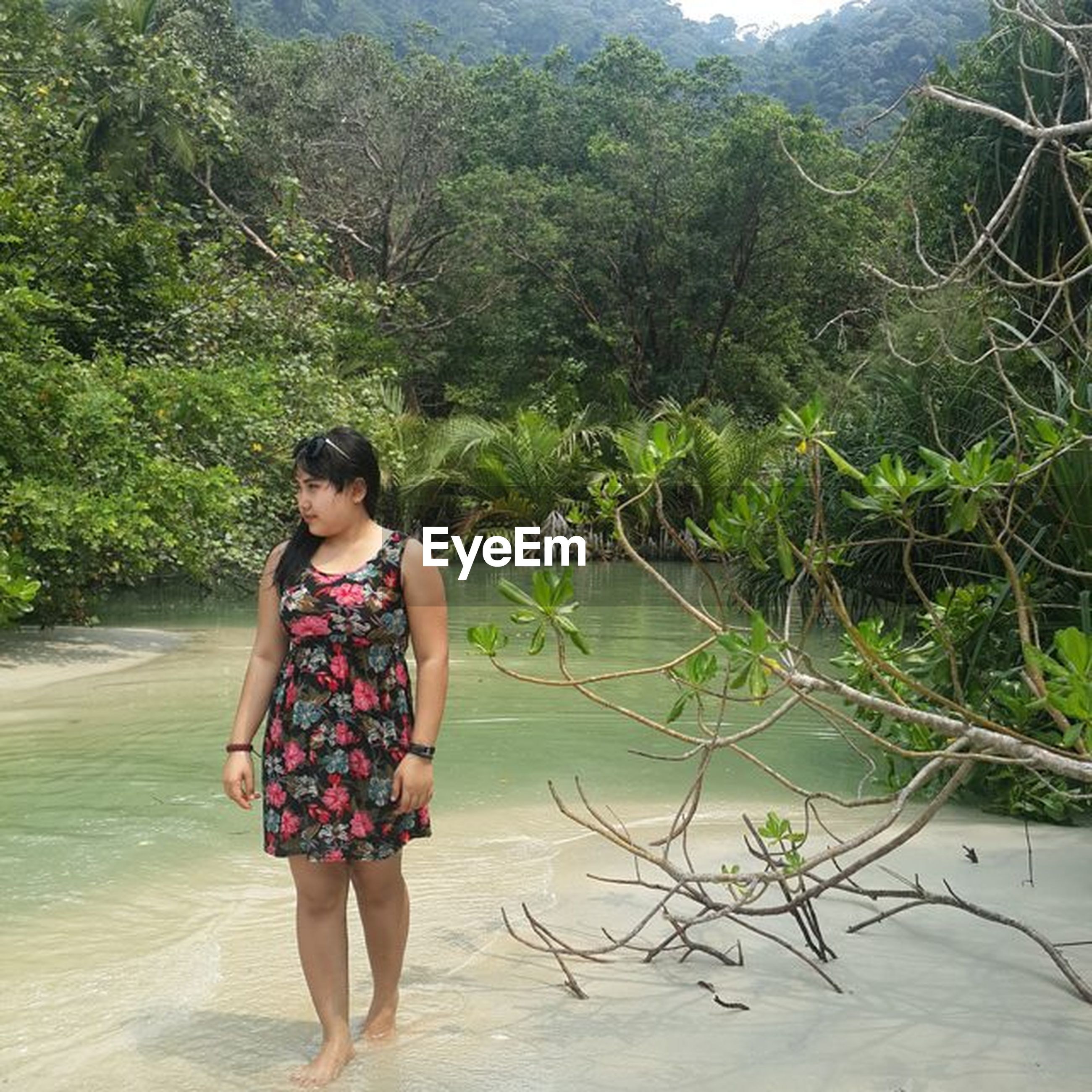 water, lifestyles, leisure activity, tree, casual clothing, full length, tranquility, lake, nature, beauty in nature, tranquil scene, standing, young adult, person, vacations, scenics, river, three quarter length