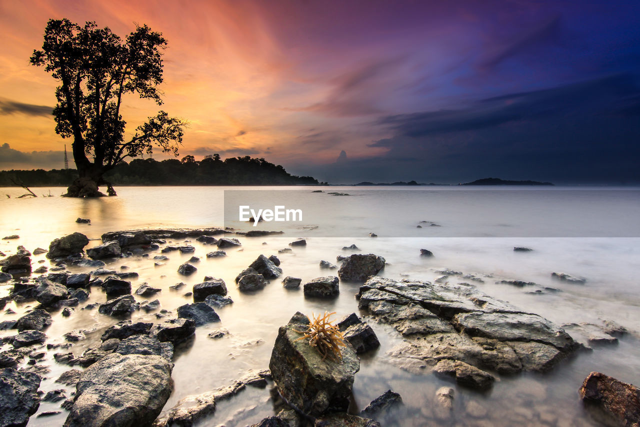 sunset, sky, nature, beauty in nature, scenics, tranquil scene, cloud - sky, tranquility, water, rock - object, no people, sea, outdoors, tree, horizon over water, day