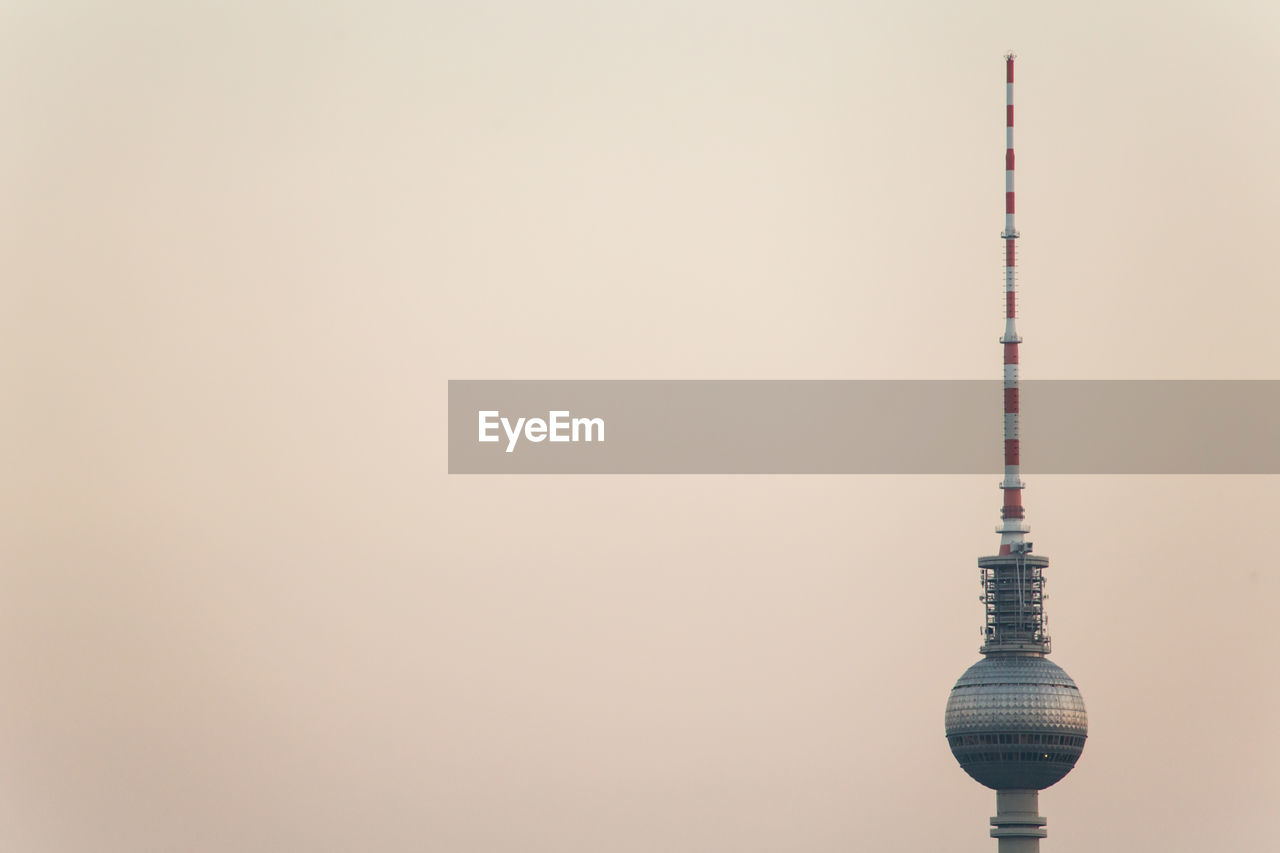 High Section Of Fernsehturm Television Tower Against Clear Sky During Sunset