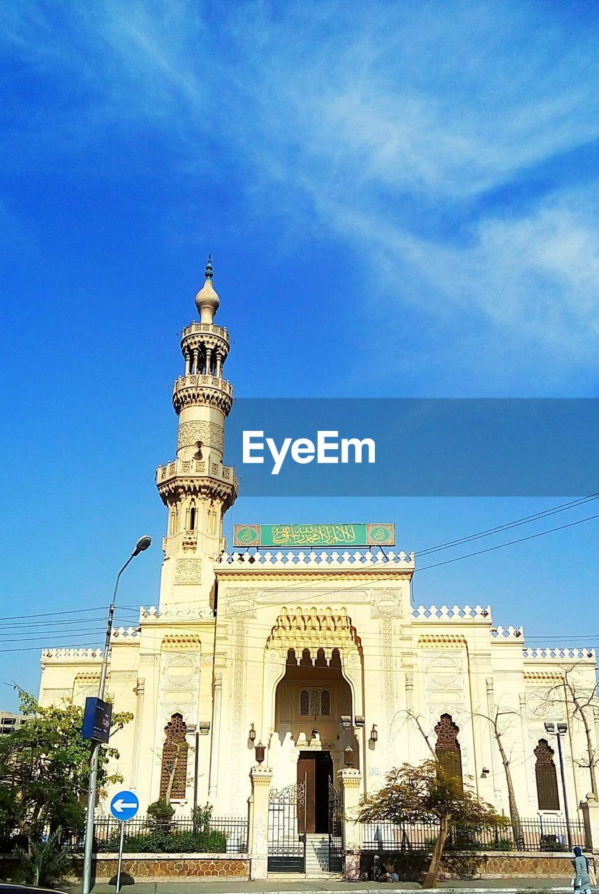 architecture, built structure, blue, building exterior, religion, low angle view, sky, spirituality, day, outdoors, history, arch, place of worship, travel destinations, sculpture, dome, statue, no people, city