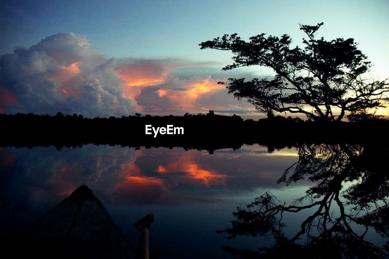 sunset, silhouette, tree, sky, nature, scenics, tranquil scene, cloud - sky, reflection, beauty in nature, outdoors, tranquility, no people, water, lake, dawn, day