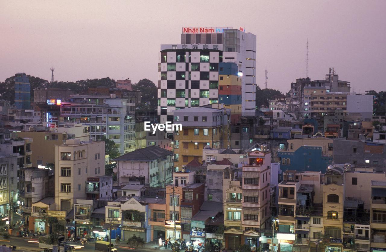Illuminated Cityscape Against Clear Sky At Dusk