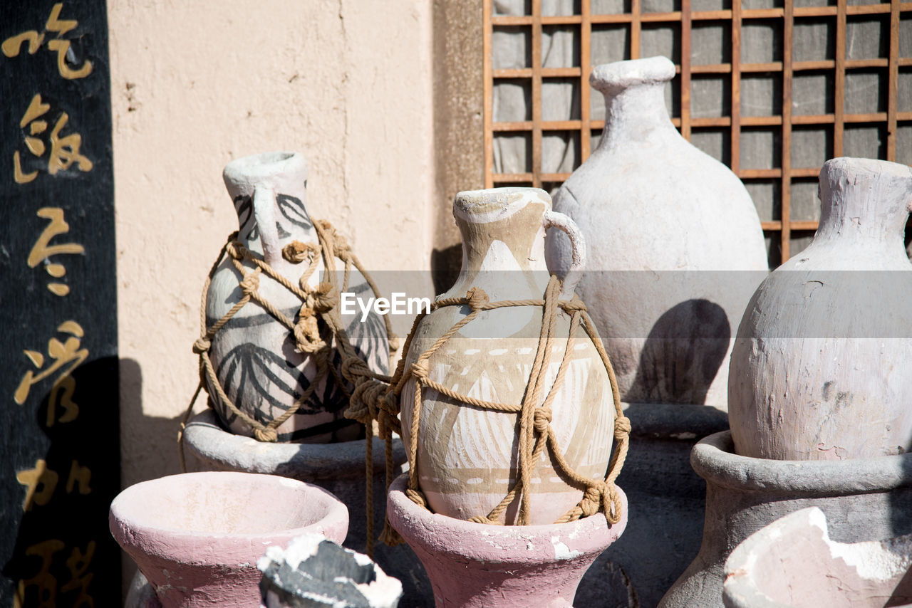 art and craft, craft, sculpture, creativity, human representation, statue, representation, no people, architecture, day, male likeness, wall - building feature, pottery, container, carving - craft product, ceramics, built structure, outdoors, pot