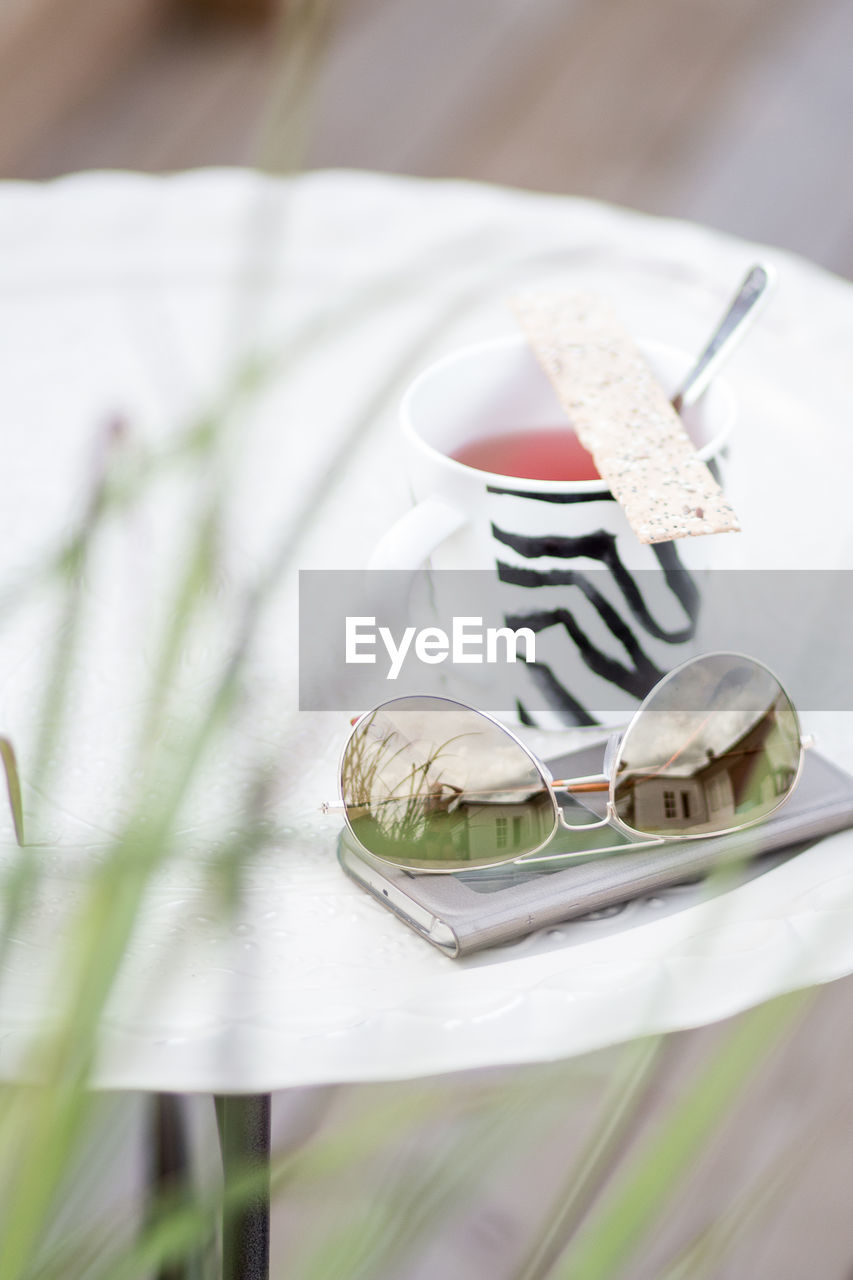 food and drink, plate, table, selective focus, eating utensil, no people, food, still life, close-up, kitchen utensil, indulgence, ready-to-eat, freshness, sweet food, dessert, spoon, sweet, white color, indoors, fork, temptation, crockery