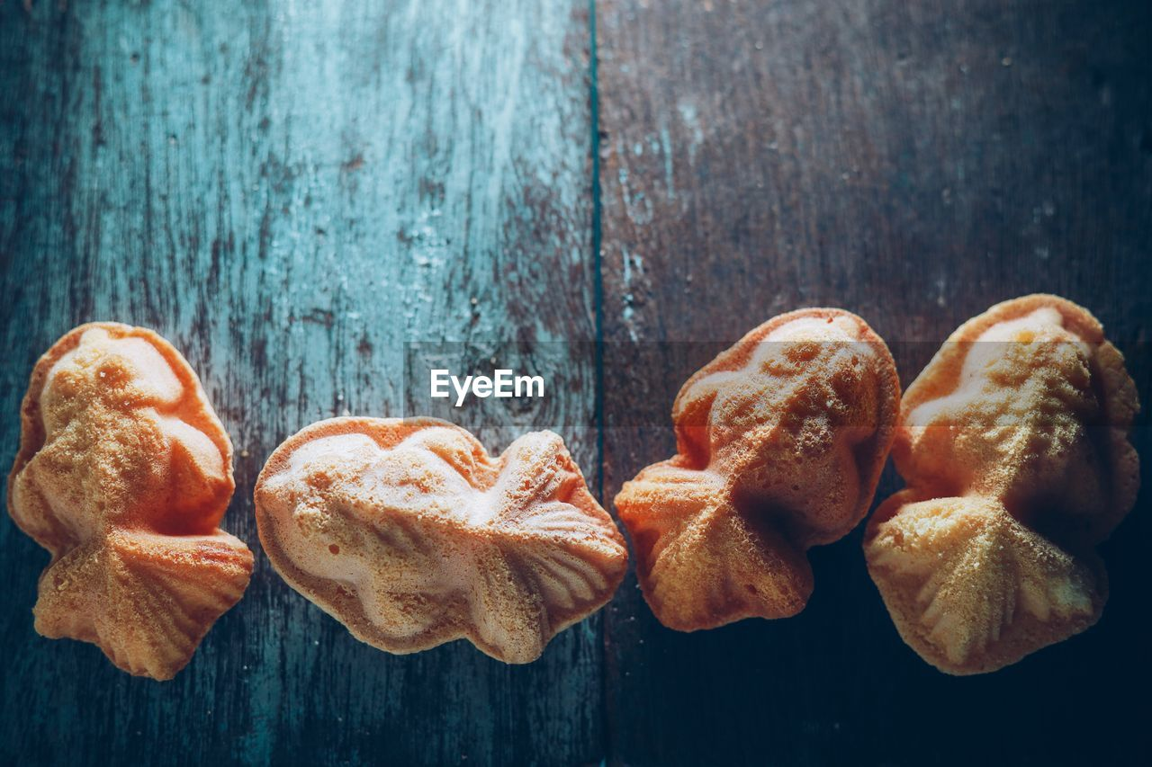 food and drink, food, still life, freshness, table, wood - material, no people, indoors, close-up, directly above, baked, high angle view, sweet food, wellbeing, ready-to-eat, bread, indulgence, day, group of objects, focus on foreground, snack, temptation