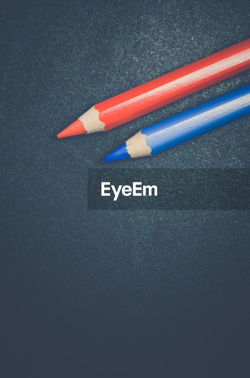 Directly Above Shot Of Red And Blue Pencils