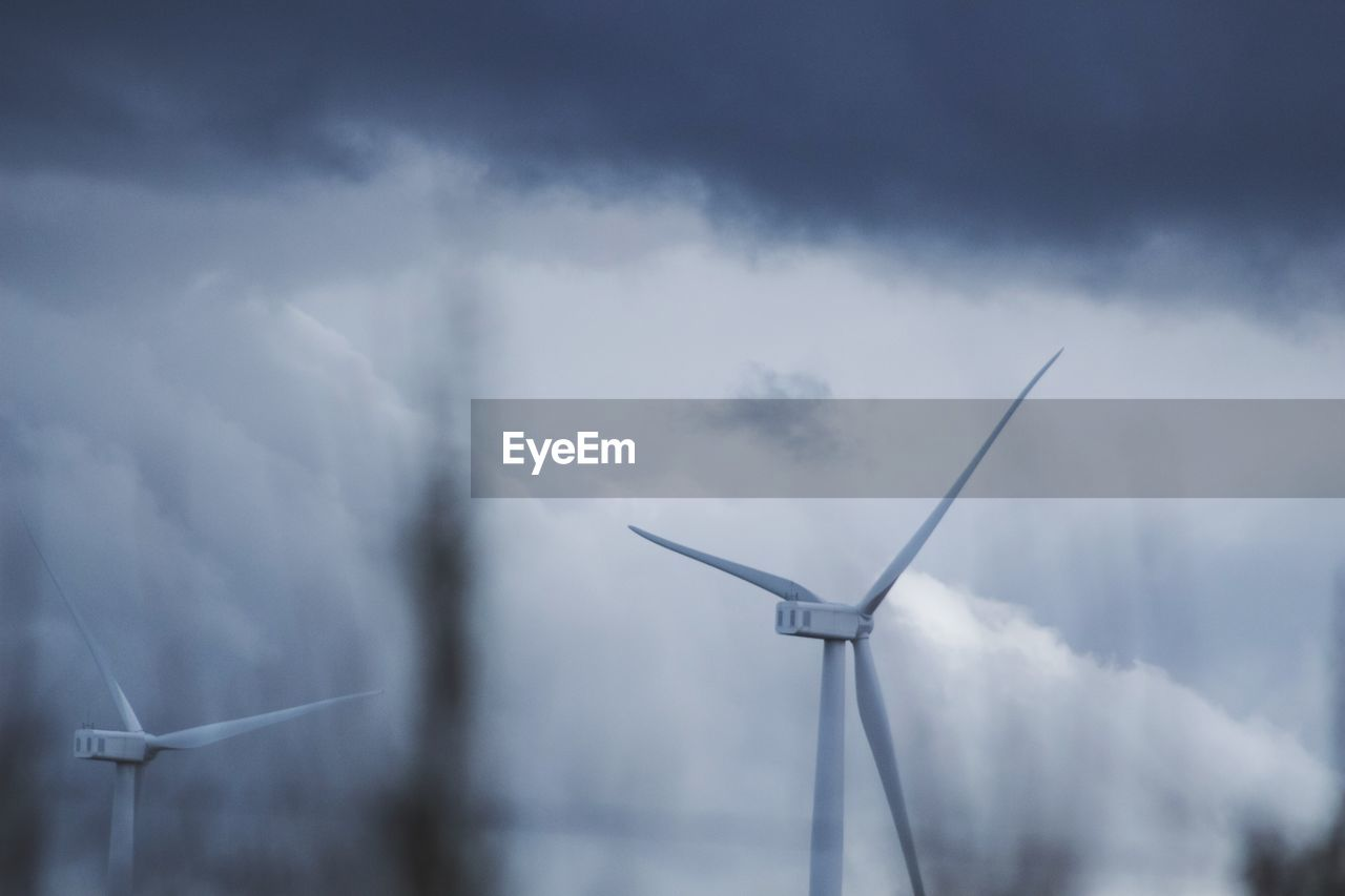 cloud - sky, wind turbine, fuel and power generation, turbine, renewable energy, alternative energy, sky, wind power, environmental conservation, environment, nature, technology, low angle view, day, sustainable resources, outdoors, no people, beauty in nature, rural scene, power in nature, power supply