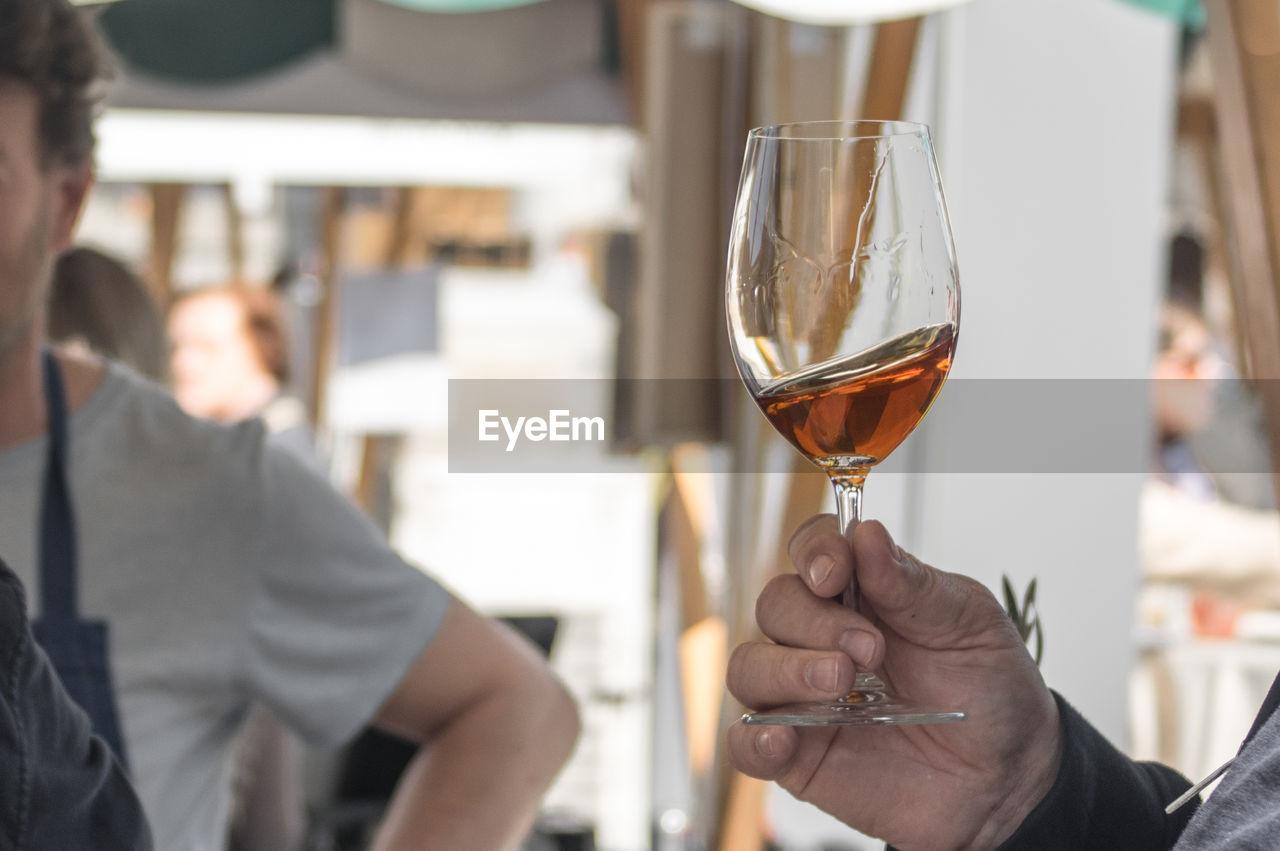 Close-Up Of A Man Tasting Wine