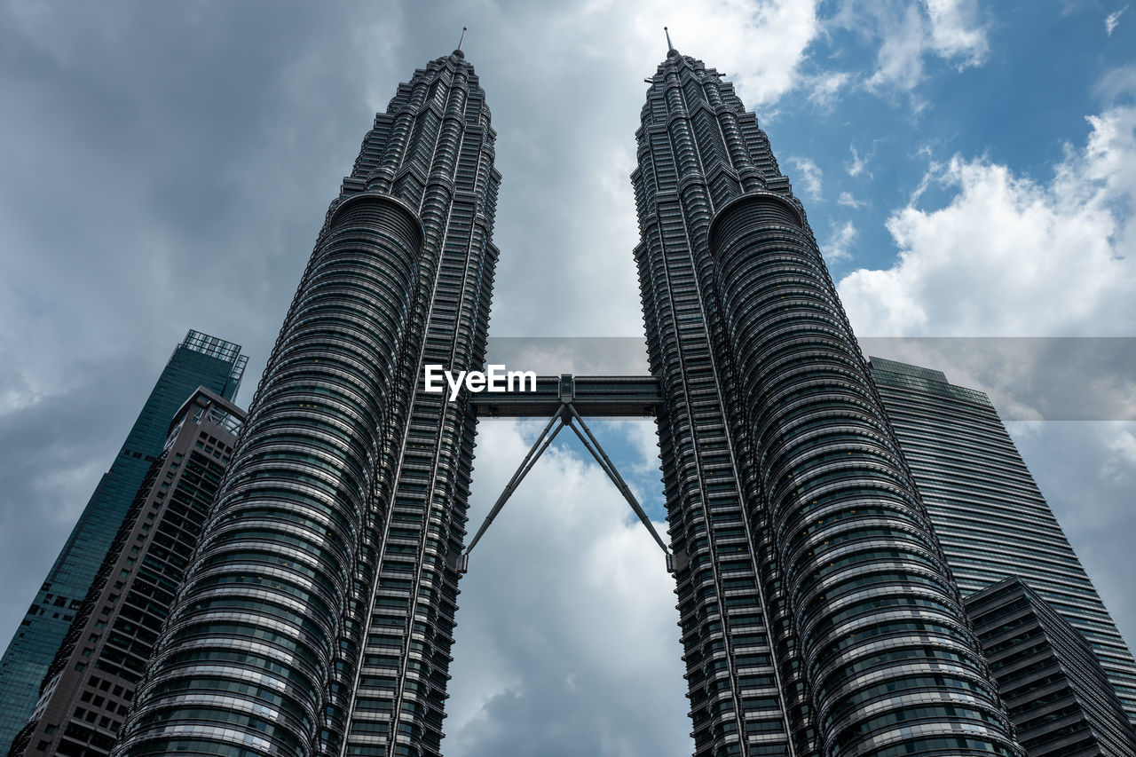 architecture, built structure, cloud - sky, tall - high, sky, building exterior, office building exterior, city, modern, skyscraper, tower, travel destinations, nature, low angle view, tourism, no people, building, travel, outdoors, financial district, spire