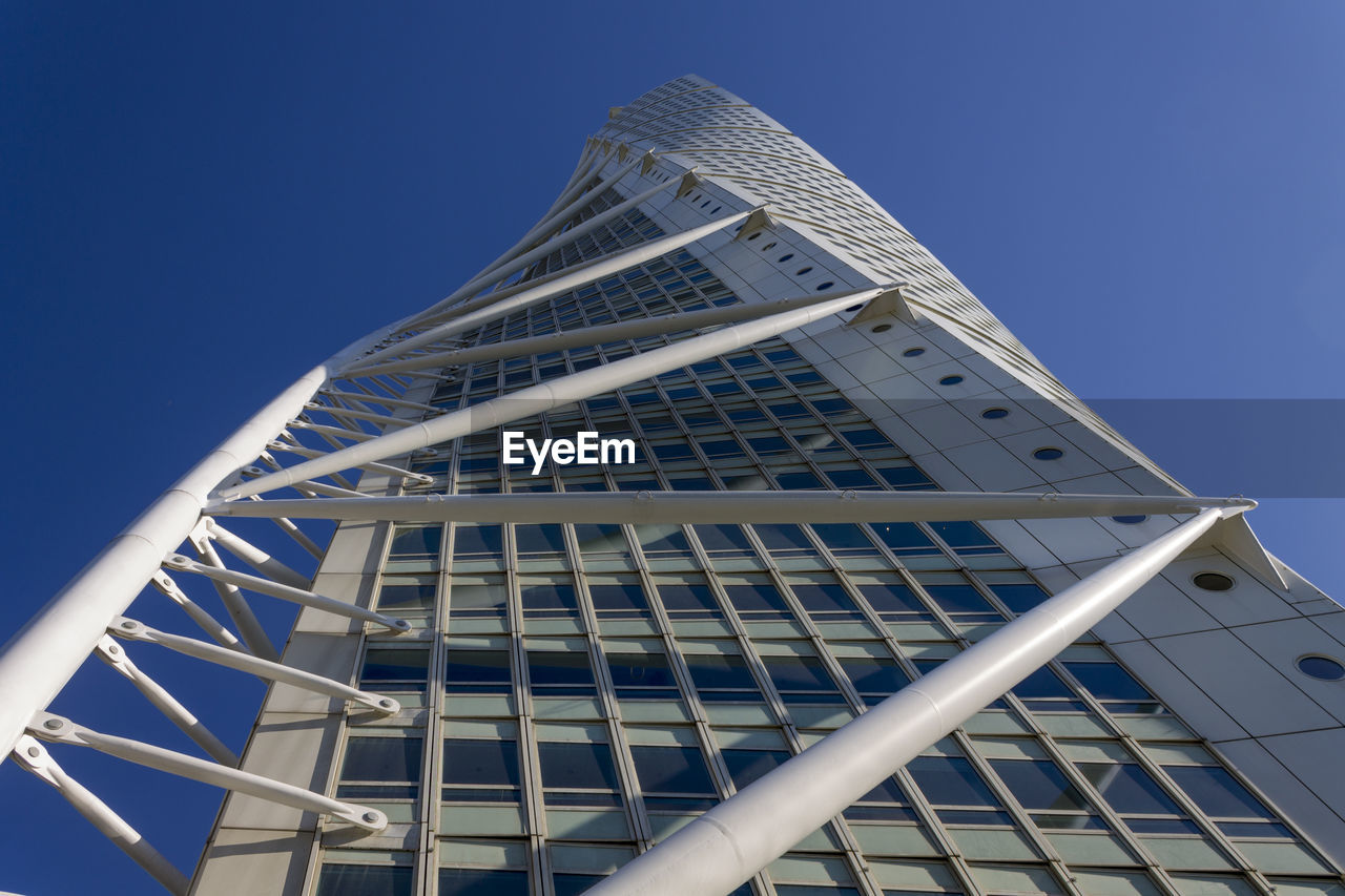 architecture, built structure, low angle view, building exterior, sky, building, office building exterior, clear sky, modern, city, no people, tall - high, blue, nature, office, day, skyscraper, tower, sunlight, outdoors