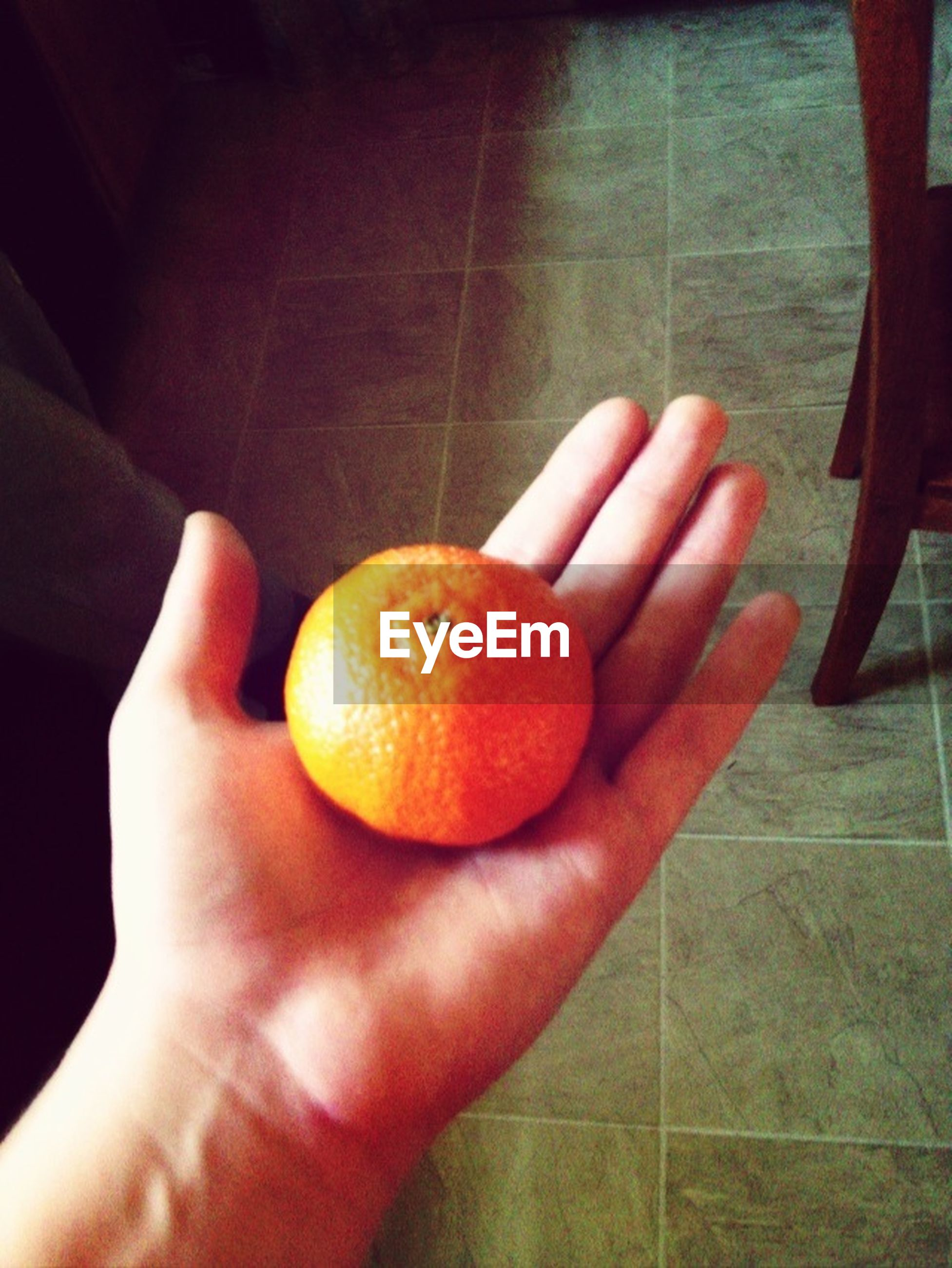 food and drink, person, food, healthy eating, fruit, freshness, indoors, part of, holding, cropped, personal perspective, unrecognizable person, close-up, human finger, orange - fruit, orange color, healthy lifestyle