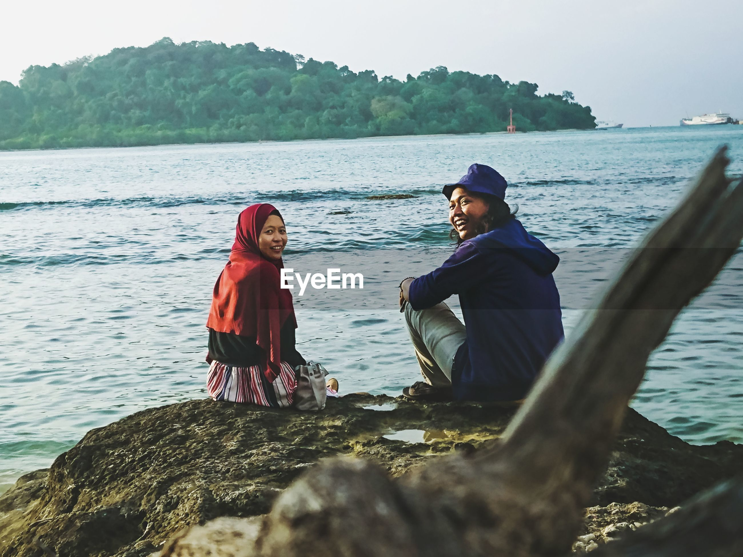 Smile couple in merak island beach