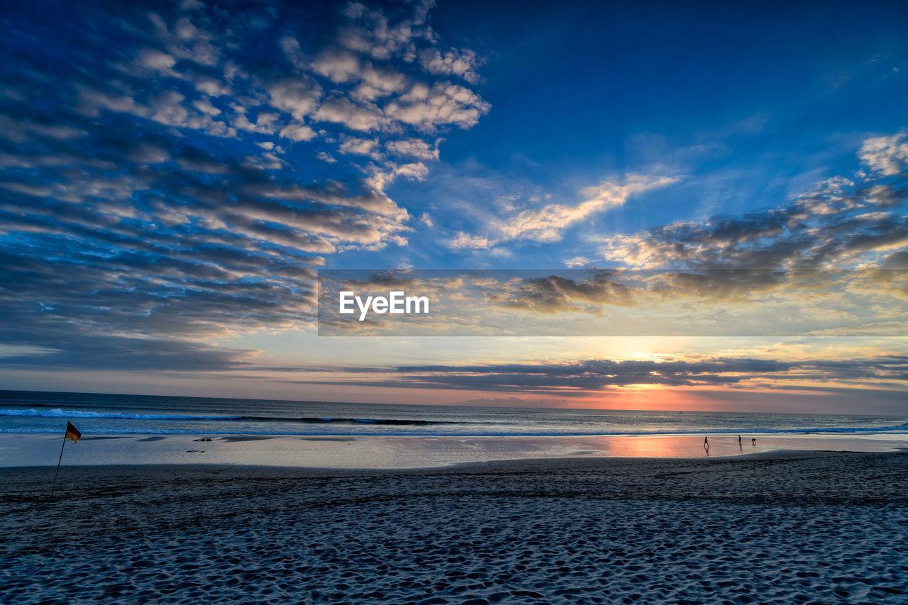 sky, cloud - sky, sea, water, scenics - nature, beauty in nature, sunset, beach, land, horizon over water, tranquility, tranquil scene, horizon, nature, idyllic, non-urban scene, no people, orange color, sand, outdoors
