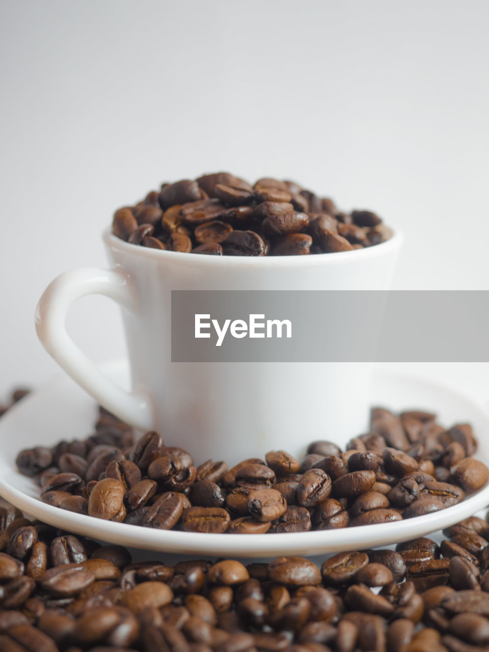 coffee, coffee - drink, food and drink, roasted coffee bean, cup, food, mug, coffee cup, still life, drink, indoors, brown, coffee bean, refreshment, close-up, freshness, no people, large group of objects, roasted, abundance, crockery, caffeine, non-alcoholic beverage