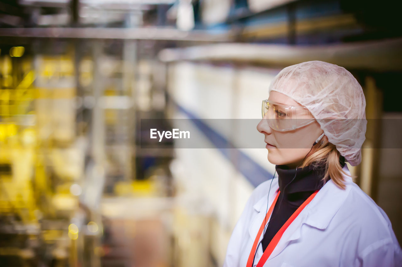Female Doctor Wearing Protective Eyewear While Working At Hospital