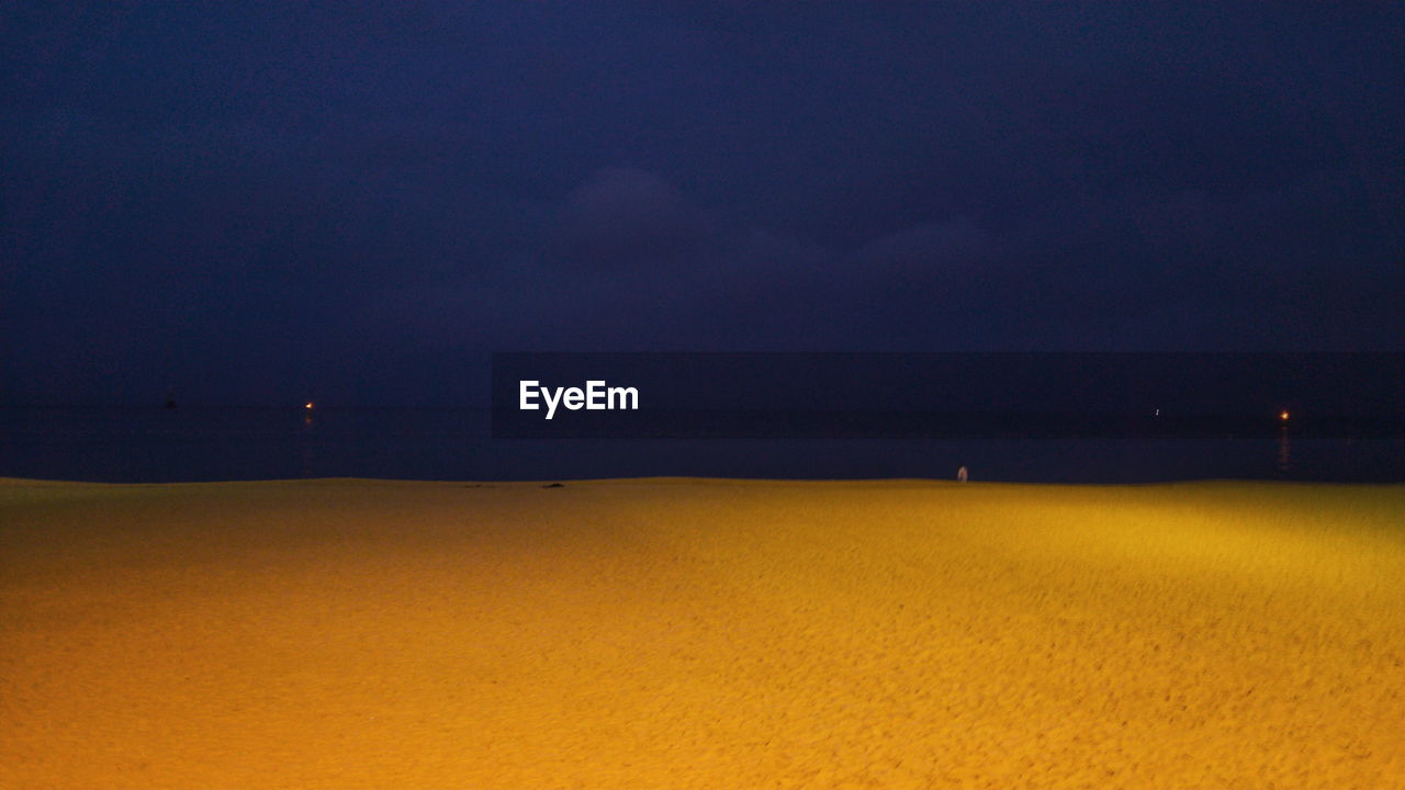 sea, tranquility, nature, scenics, tranquil scene, beauty in nature, night, outdoors, no people, sky, water, landscape, beach, yellow, horizon over water