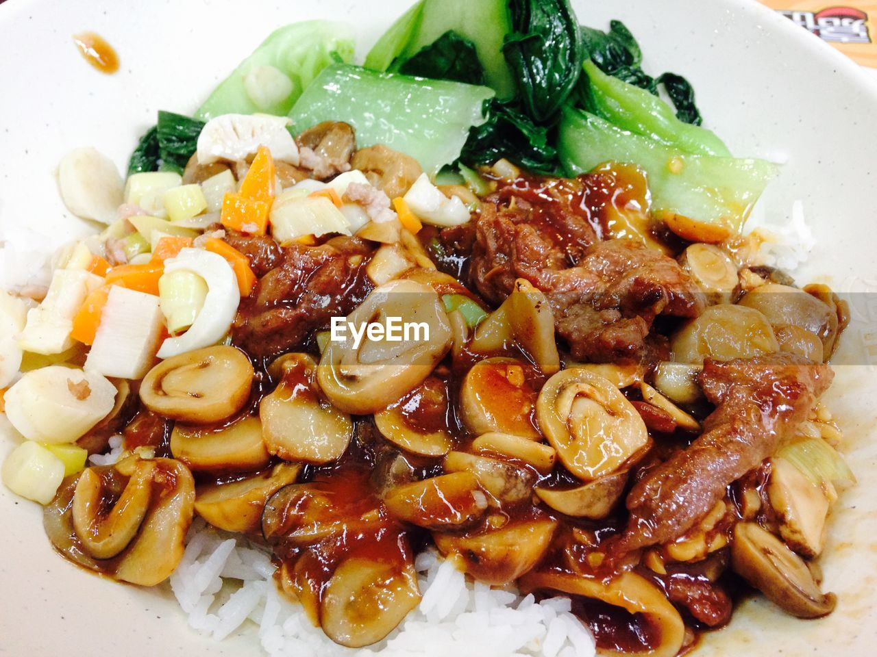 Close-up of beef and rice in plate