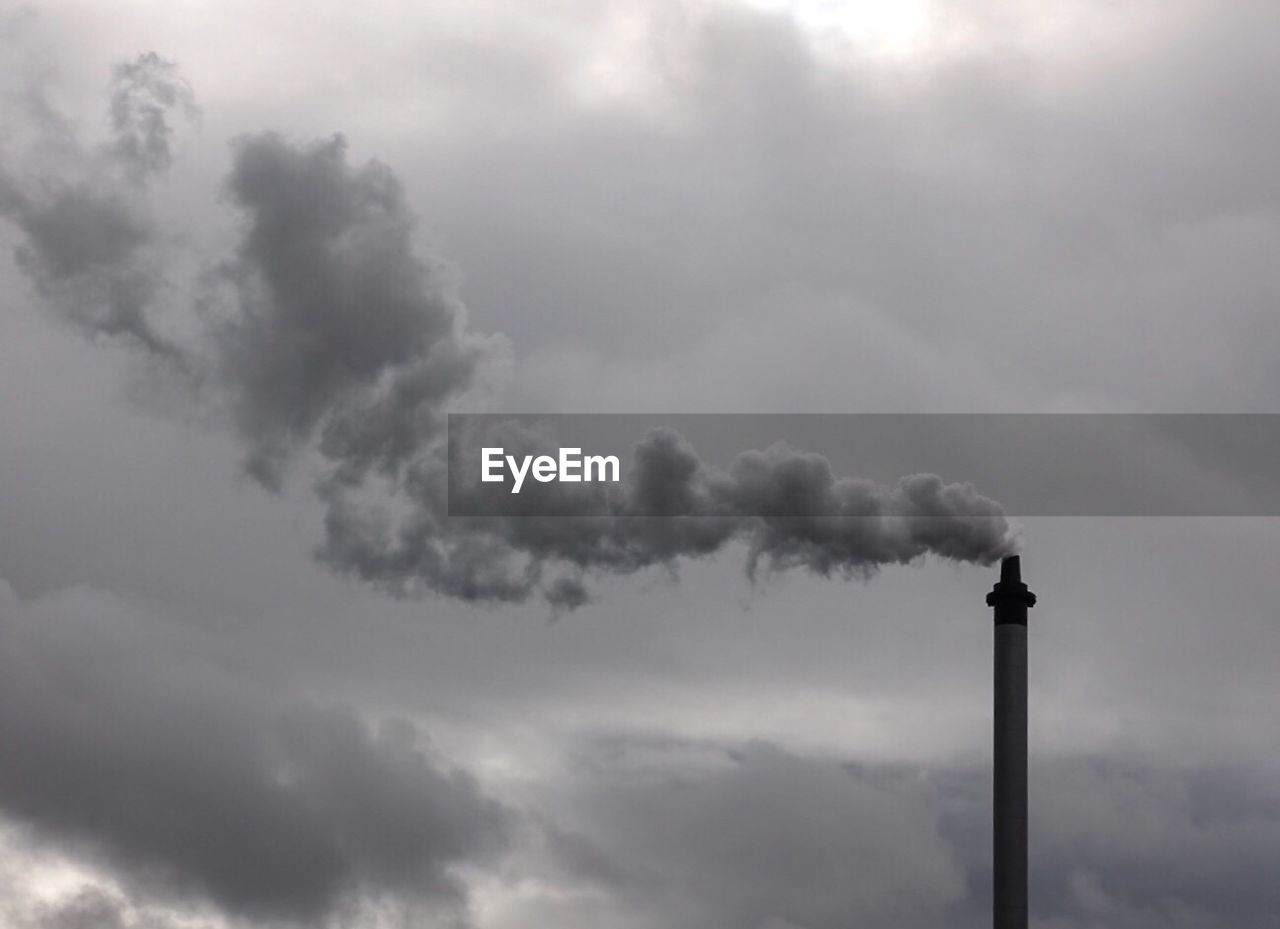 pollution, smoke stack, emitting, chimney, industry, smoke - physical structure, air pollution, factory, environment, fumes, sky, day, no people, low angle view, outdoors, cloud - sky, nature