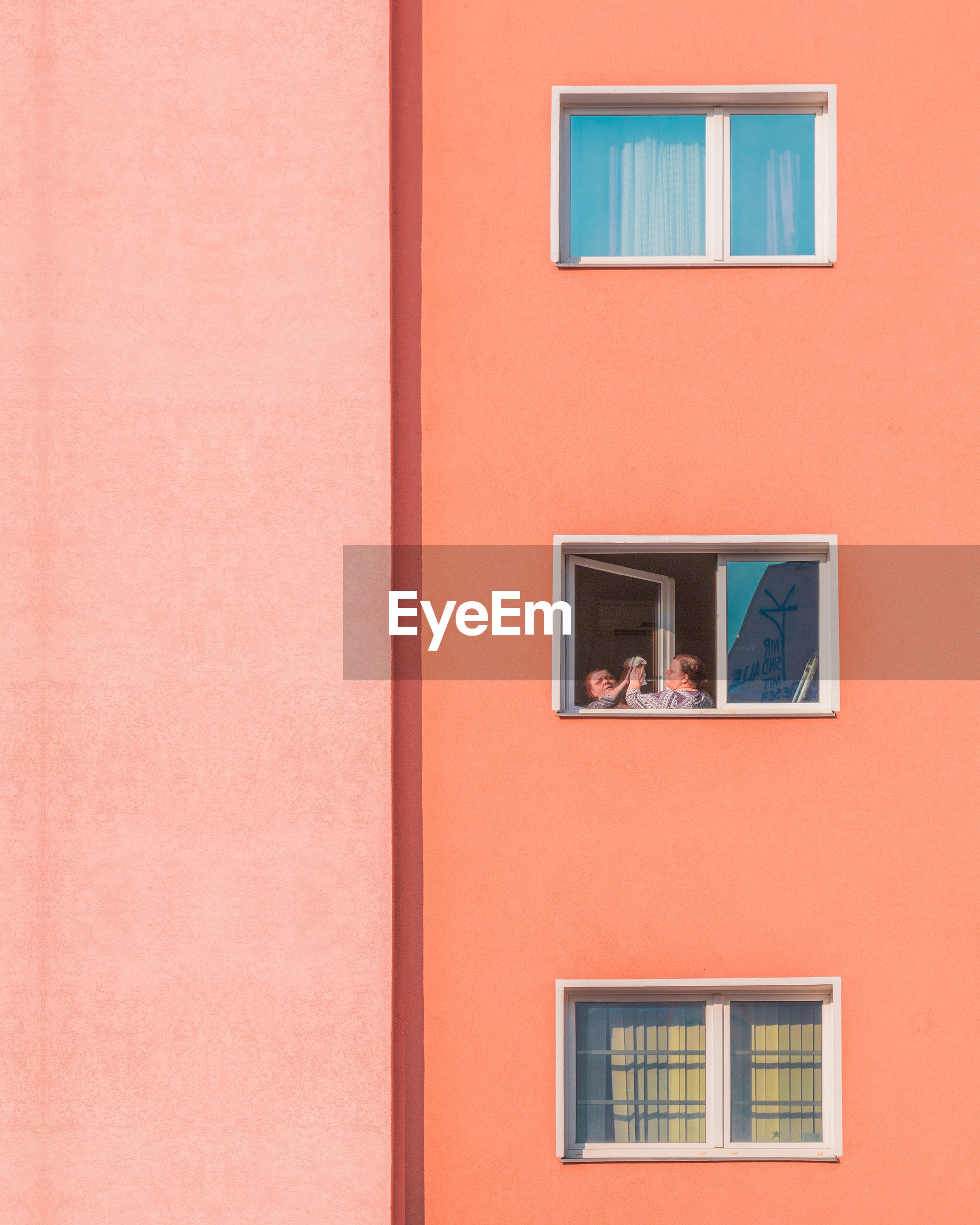 window, built structure, architecture, building exterior, wall - building feature, building, no people, day, full frame, outdoors, house, backgrounds, red, glass - material, orange color, copy space, low angle view, reflection, pink color, window frame