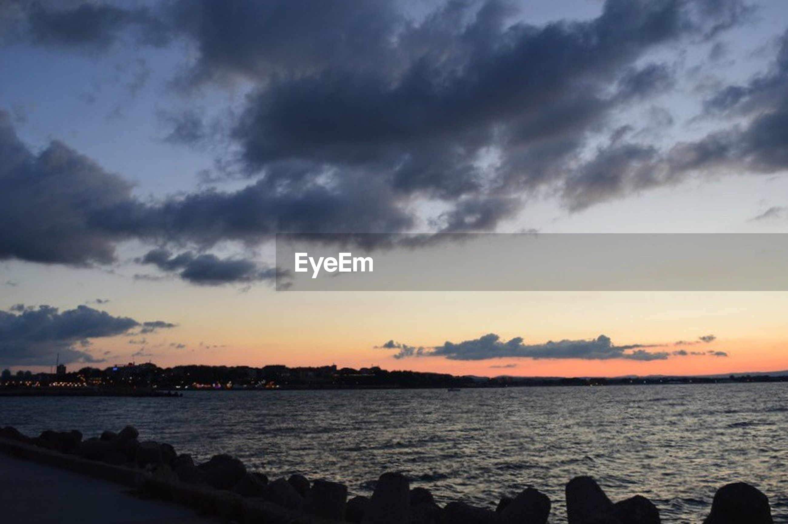 water, sea, sky, sunset, scenics, cloud - sky, beauty in nature, tranquil scene, tranquility, nature, horizon over water, cloudy, idyllic, cloud, shore, outdoors, no people, calm, coastline, remote, weather, non-urban scene, ocean, overcast