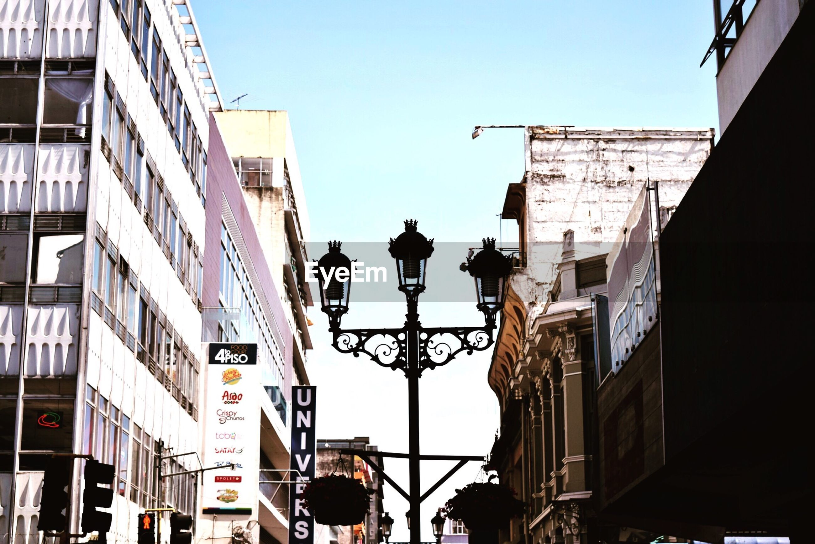 building exterior, architecture, built structure, low angle view, clear sky, building, city, street light, residential building, residential structure, window, sky, day, power line, outdoors, city life, silhouette, cable, no people, balcony