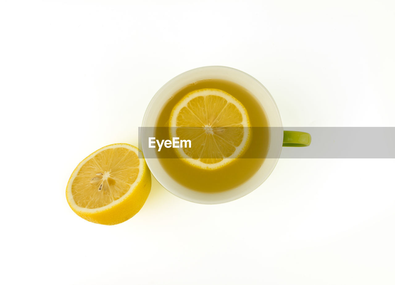 citrus fruit, food and drink, fruit, white background, still life, studio shot, healthy eating, food, lemon, freshness, slice, indoors, wellbeing, refreshment, drink, yellow, no people, copy space, cross section, close-up, tea cup, orange, temptation