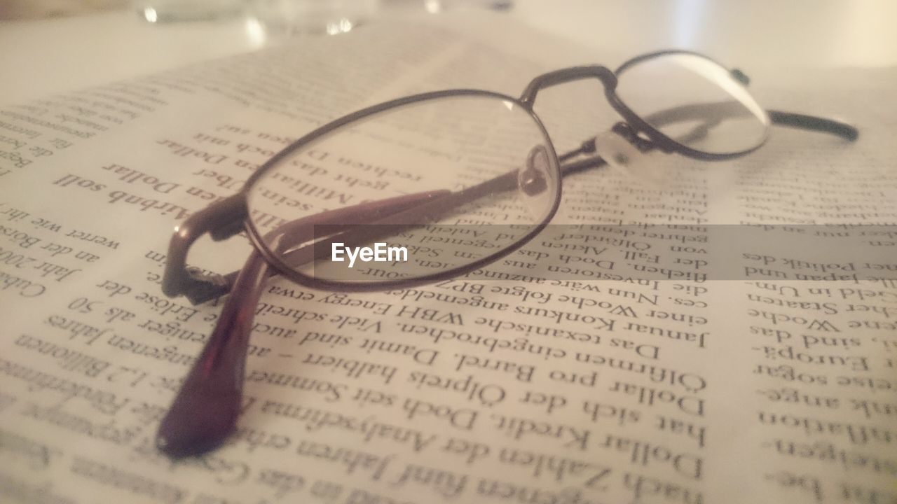 eyeglasses, text, book, paper, page, spirituality, education, vision, eyesight, communication, table, eyewear, no people, open, glasses, close-up, indoors, reading glasses, day