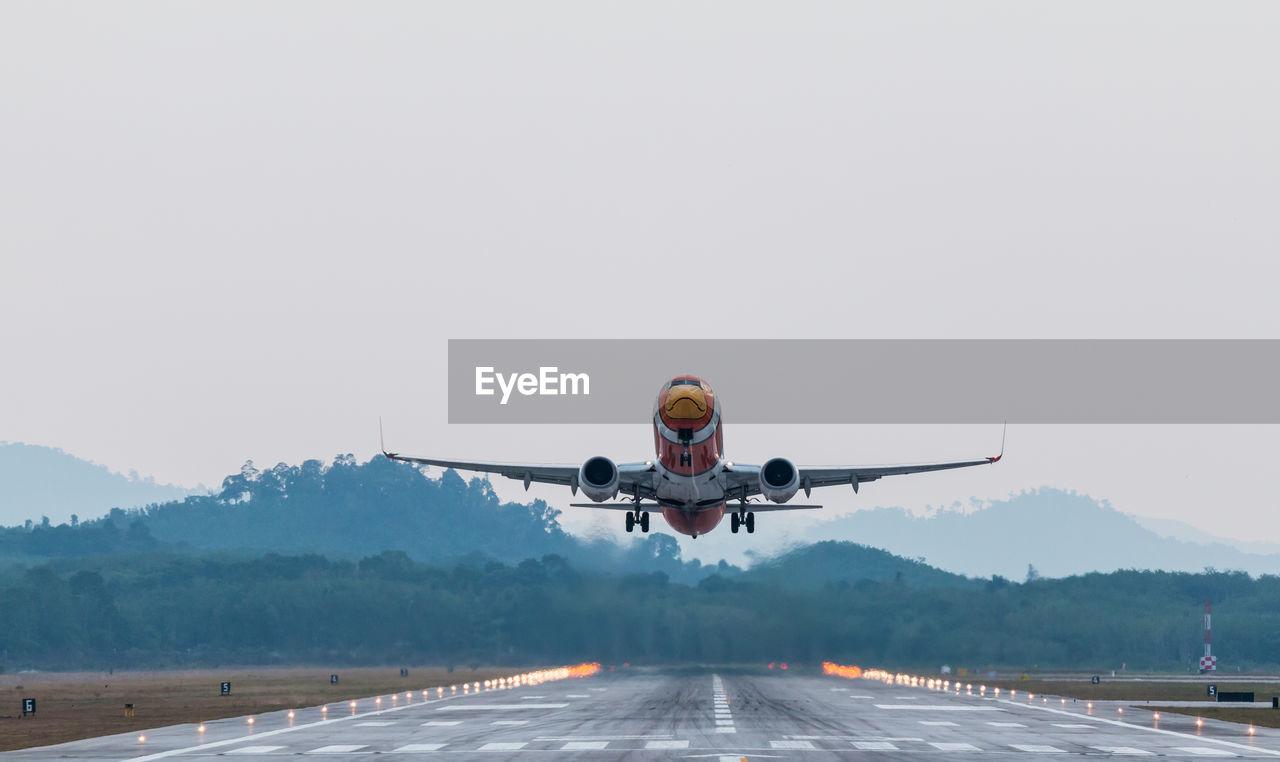 Airplane Flying On Runway Against Sky