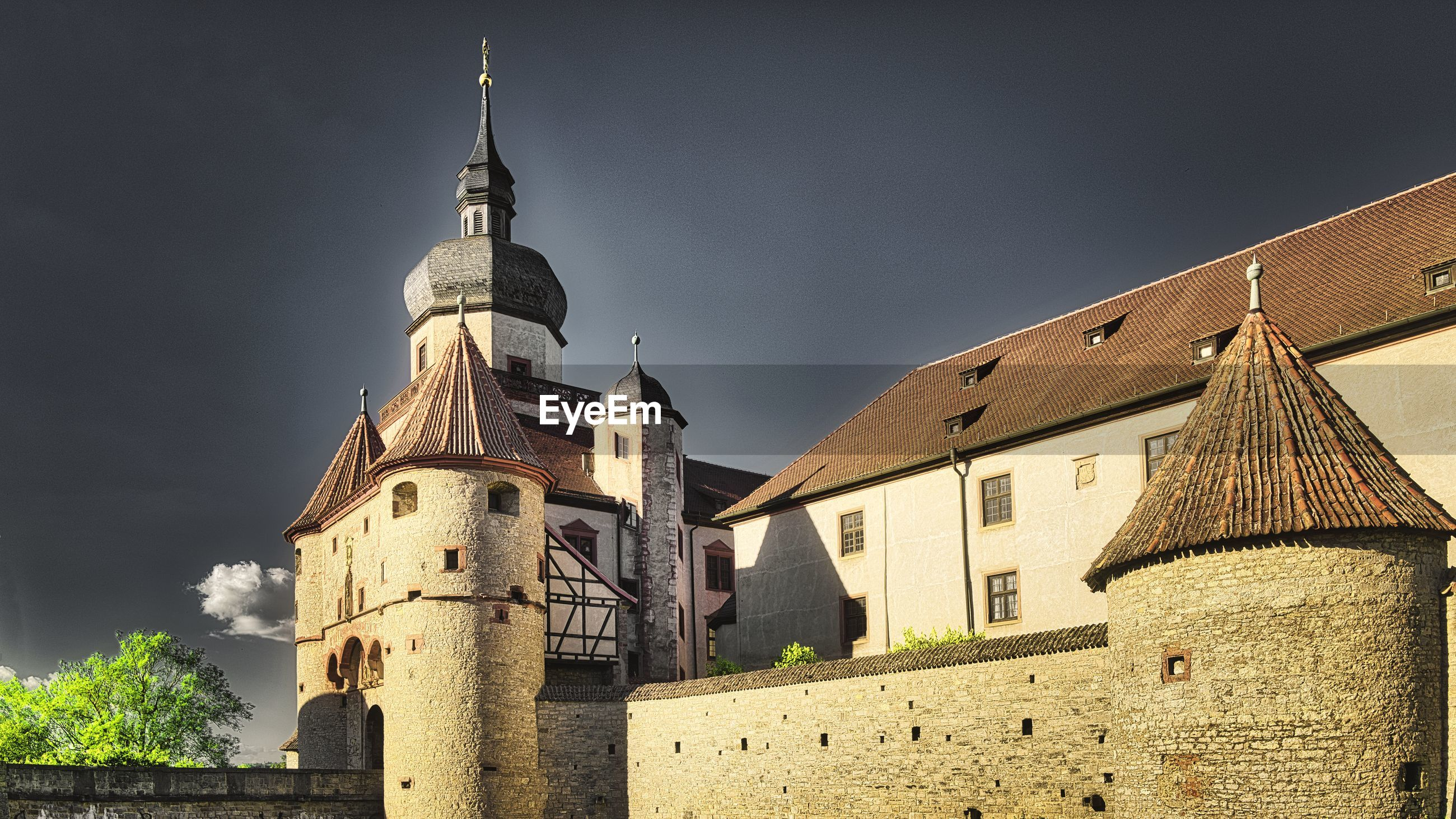 Low angle view of fortress marienberg against sky