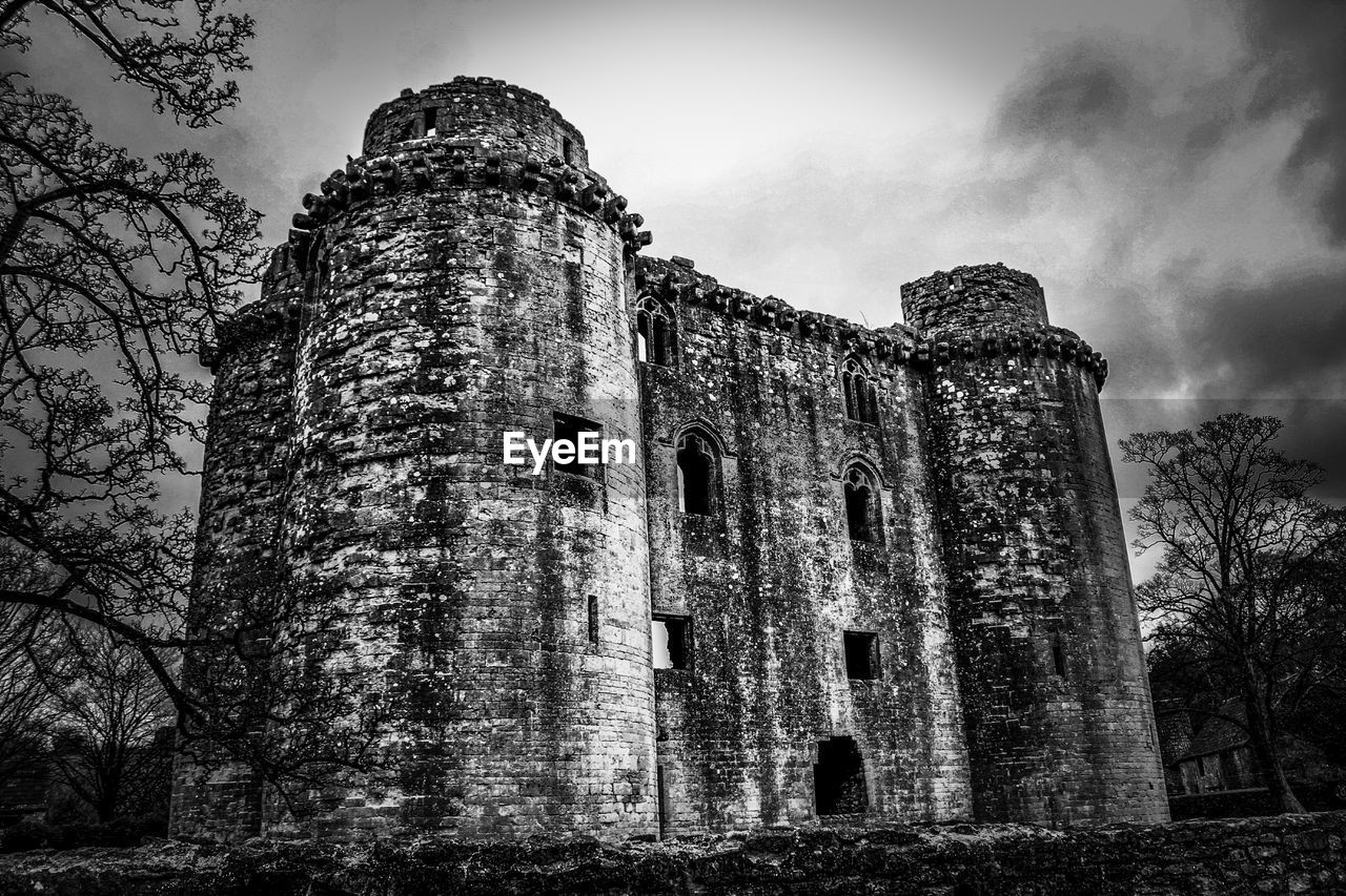 architecture, built structure, history, sky, the past, low angle view, building exterior, old, old ruin, nature, tree, no people, abandoned, day, damaged, run-down, ancient, obsolete, building, deterioration, outdoors, ruined, archaeology, ancient civilization