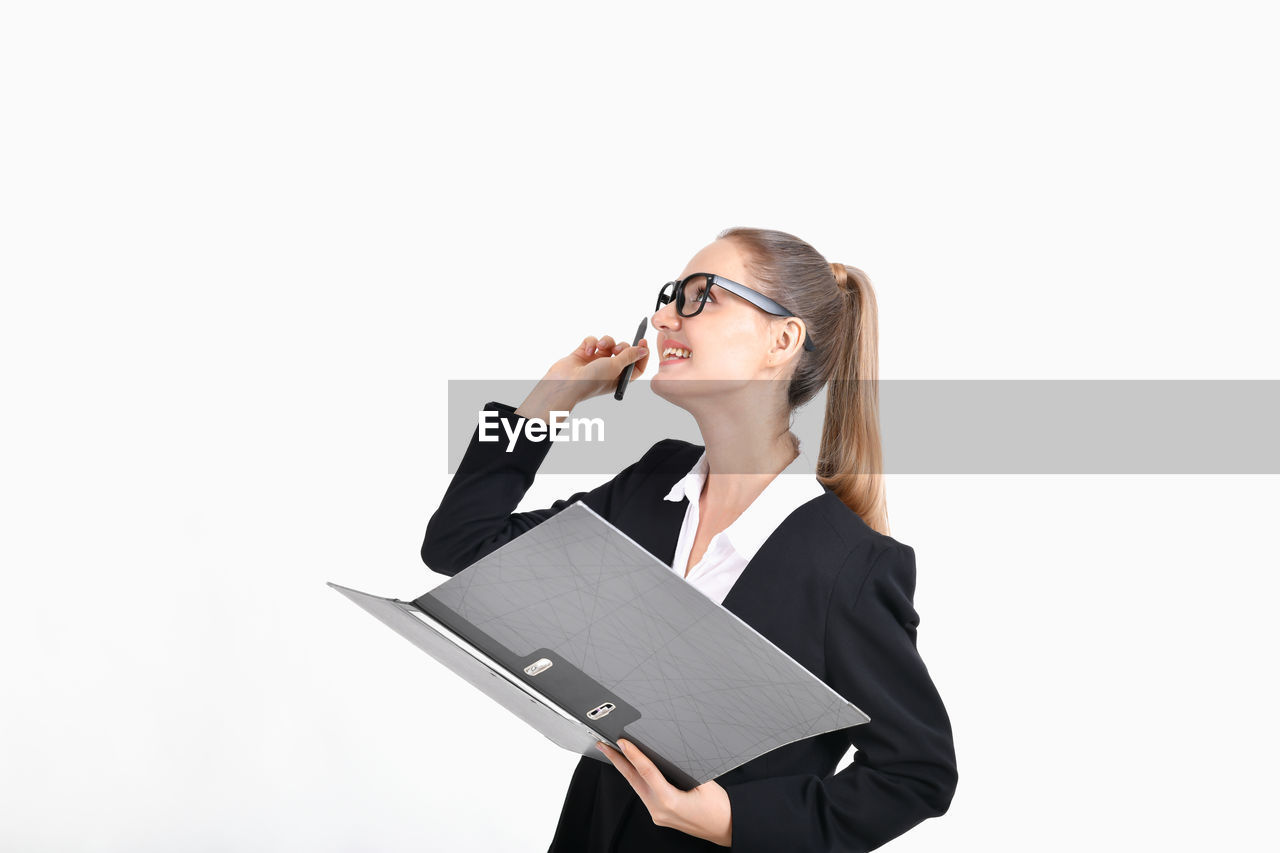 white background, studio shot, cut out, one person, holding, business person, businesswoman, young women, indoors, front view, women, young adult, glasses, copy space, adult, waist up, standing, business, hairstyle
