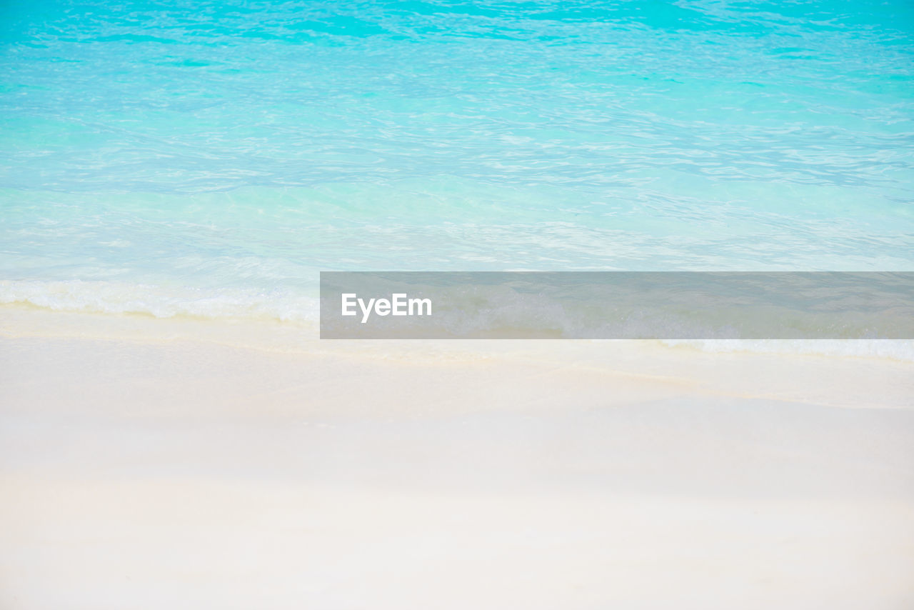 sea, water, beauty in nature, beach, land, scenics - nature, tranquility, nature, tranquil scene, day, motion, idyllic, no people, blue, outdoors, sand, sky, wave, cloud - sky, turquoise colored