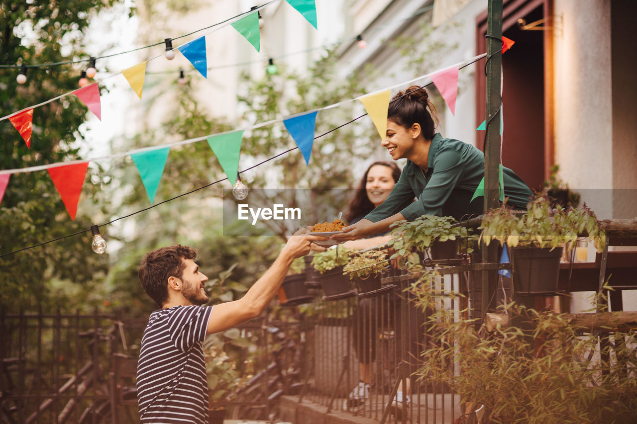 child, childhood, women, leisure activity, casual clothing, togetherness, emotion, real people, lifestyles, standing, men, plant, boys, two people, females, happiness, males, three quarter length, family, positive emotion, innocence