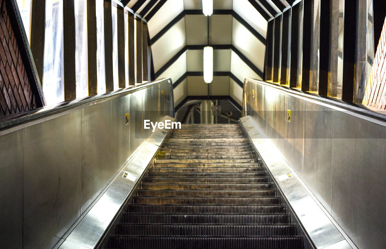 Low Angle View Of Empty Escalator At Subway Station