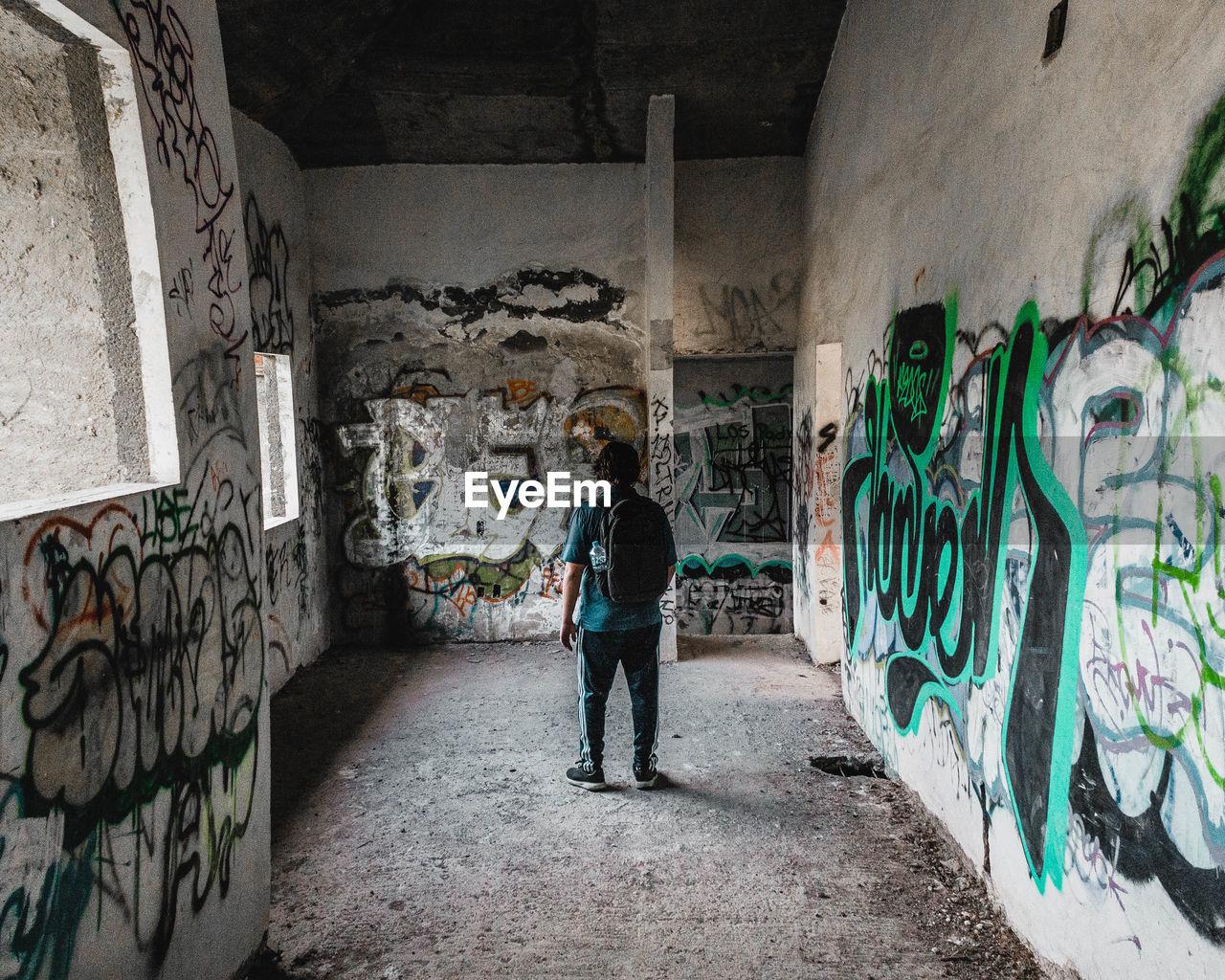 FULL LENGTH OF MAN STANDING ON FLOOR