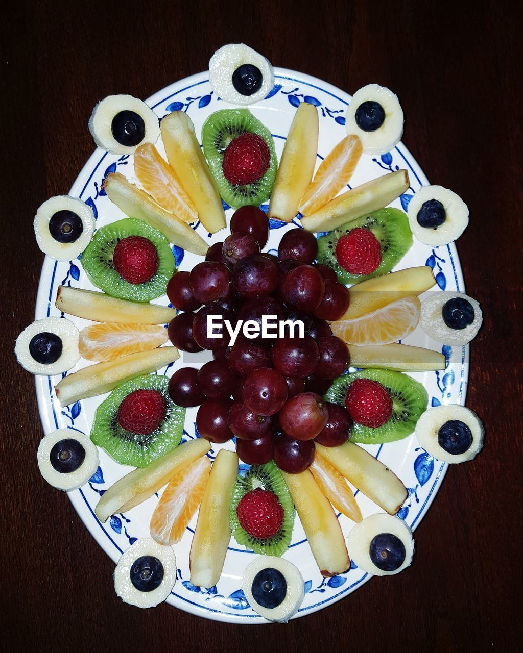 fruit, food and drink, blueberry, food, berry fruit, kiwi - fruit, strawberry, freshness, healthy eating, slice, still life, kiwi, banana, variation, close-up, ready-to-eat, high angle view, table, no people, indoors, raspberry, grape, directly above, dessert, garnish