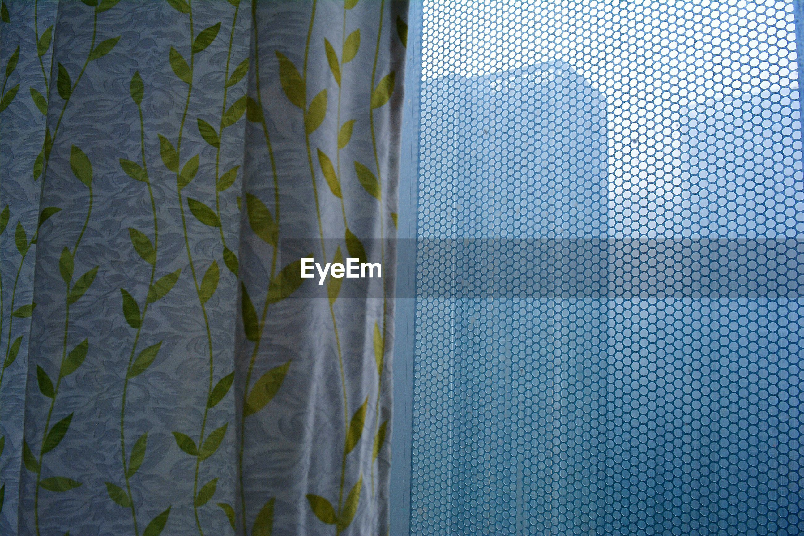 Curtain against netted window