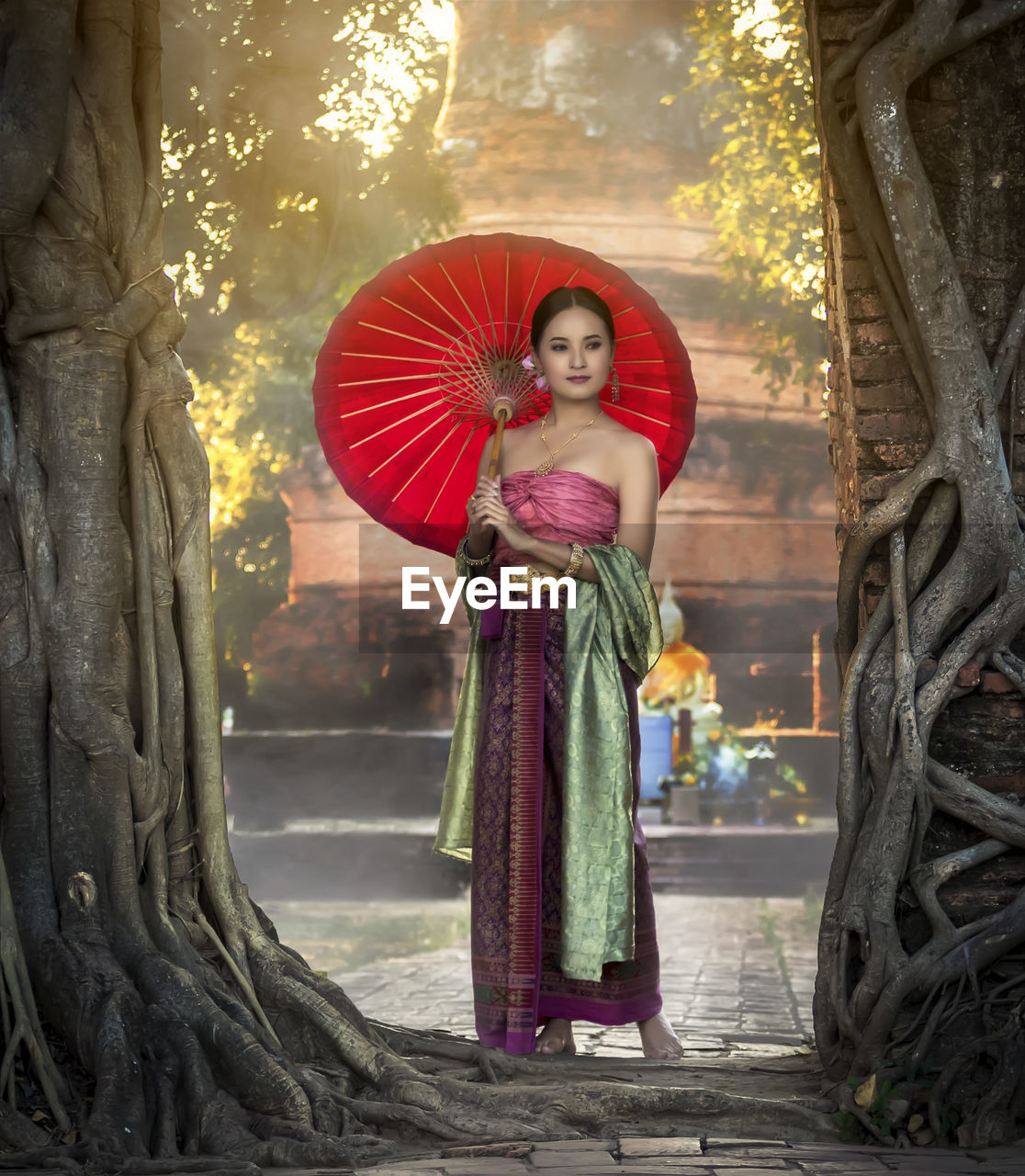 Full length of woman wearing traditional clothing while standing by trees